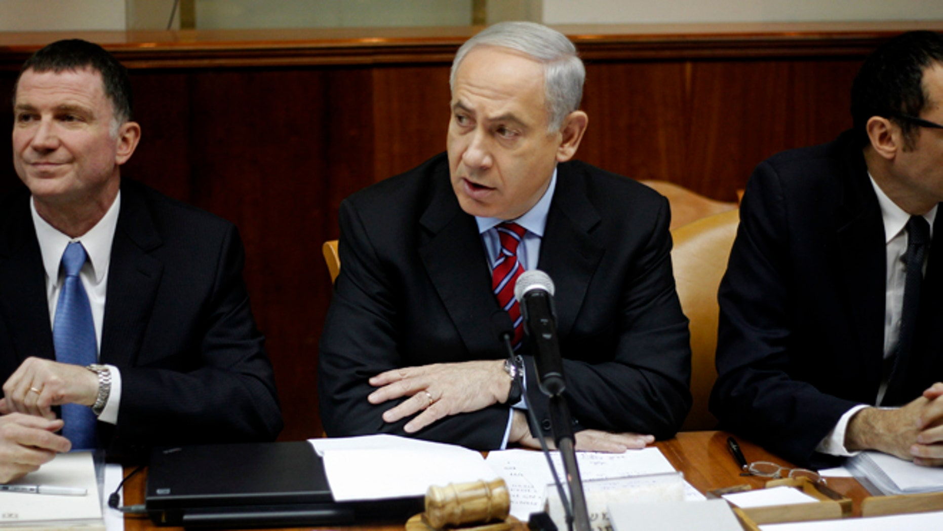 Jan. 27, 2013: Israeli Prime Minister Benjamin Netanyahu, center, heads the weekly Cabinet meeting at his Jerusalem office. Sitting left is Cabinet minister Yuli Edelstein.