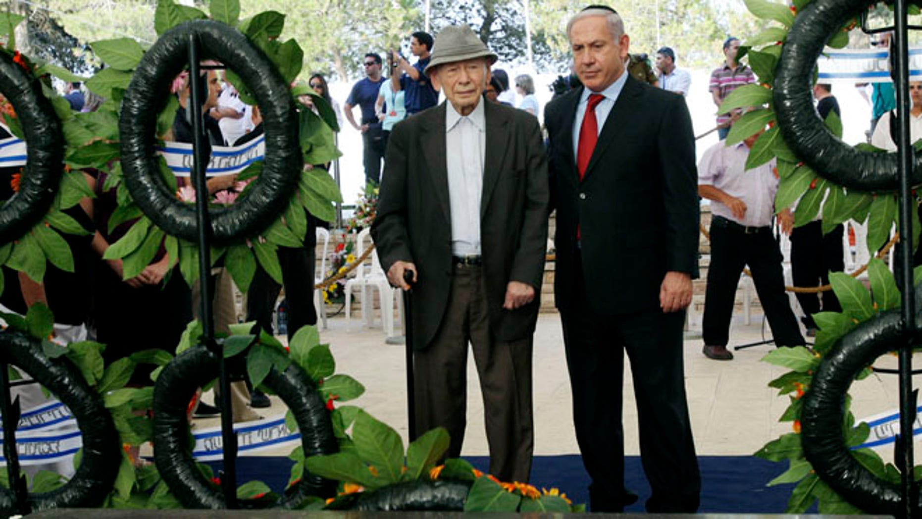 In this July 11, 2010 file photo  Israeli Prime Minister Benjamin Netanyahu, right, and his father Benzion attend the official memorial service for the late Zionist leader Ze'ev Jabotinsky at the Mt. Herzl cemetery in Jerusalem.