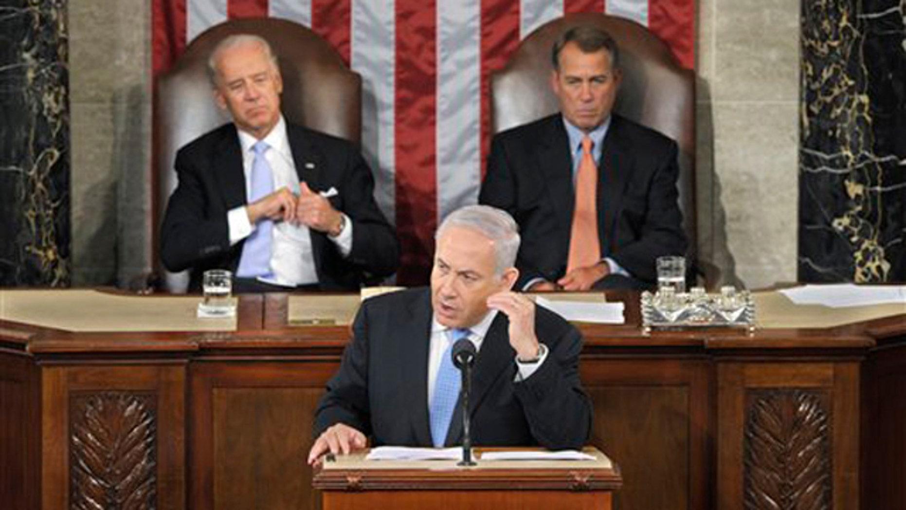 Israel's Prime Minister Benjamin Netanyahu gestures while addressing a joint meeting of Congress in Washington May 24. House Speaker John Boehner, right, and Vice President Joe Biden listen.