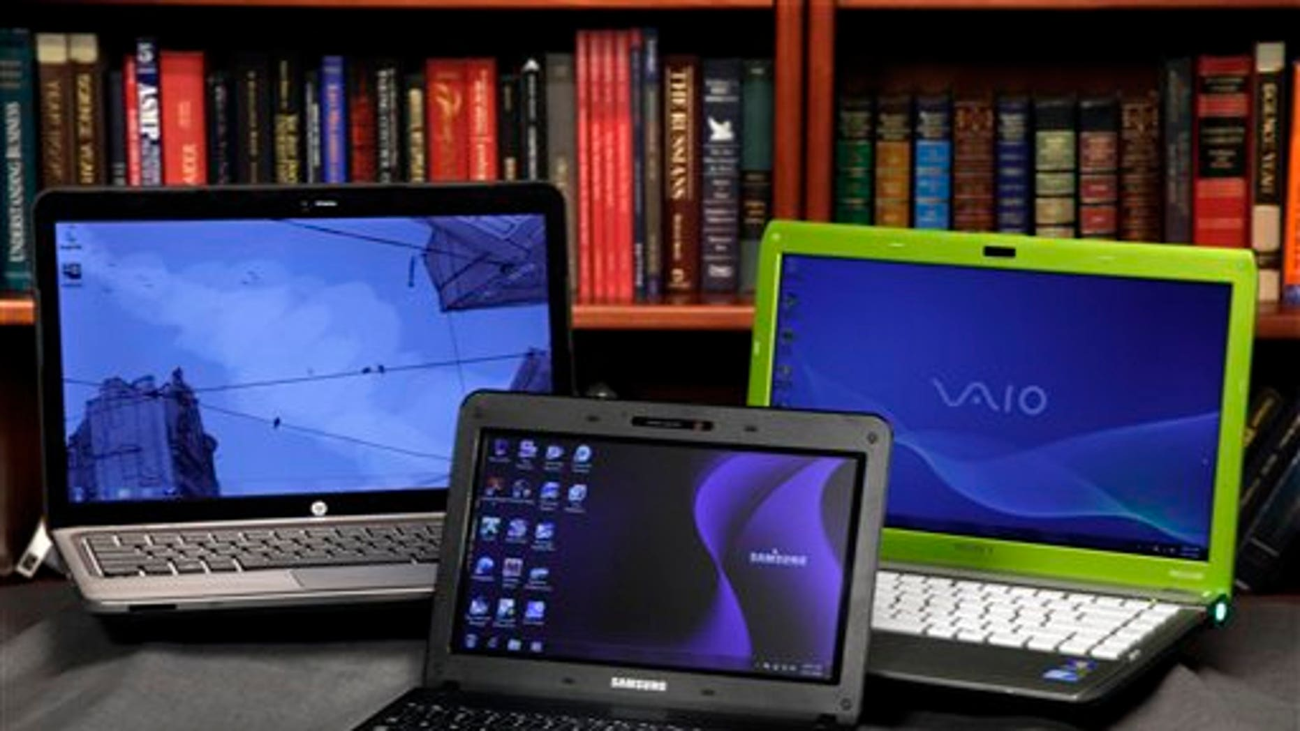 The HP Pavilion dm4, left, the Sony Vaio, right, laptops and the Samsung NB30 netbook are shown in this photo, in New York, Wednesday, Aug. 11, 2010.