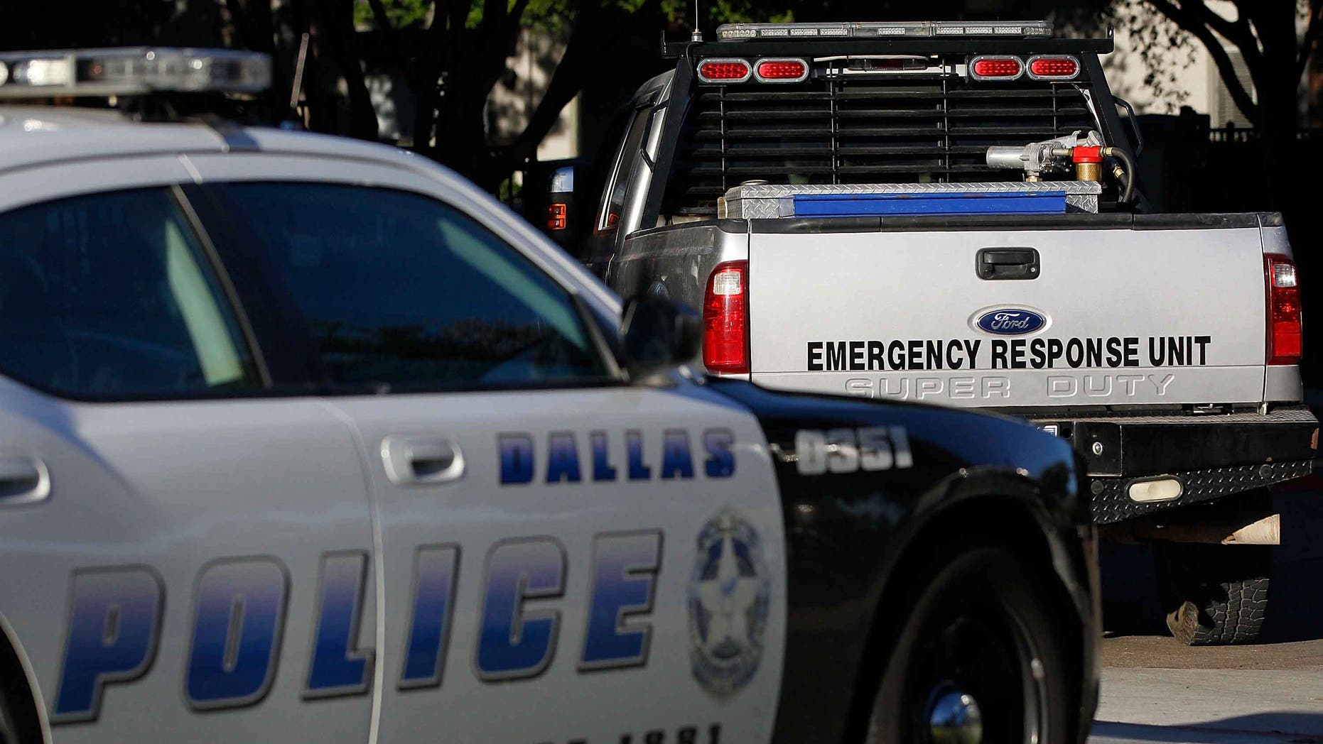 DALLAS, TX - OCTOBER 16:  A Dallas police car and an emergency response vehicle sit in the parking lot at the The Village Bend East apartment complex where a second health care worker who has tested positive for the Ebola virus resides on October 16, 2014 in Dallas, Texas.  Nurse Amber Vinson joins Nina Pham as health workers who have contracted the Ebola virus at Texas Heath Presbyterian Hospital while treating patient Thomas Eric Duncan, who has since died.  (Photo by Mike Stone/Getty Images)