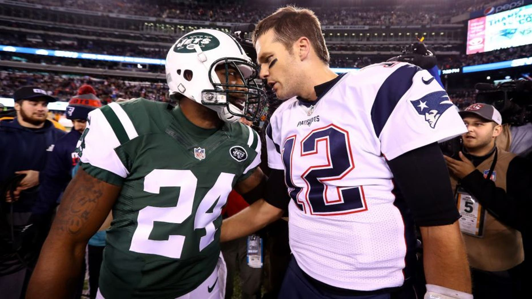 EAST RUTHERFORD, NJ - NOVEMBER 27: (L-R) Darrelle Revis #24 of the New York Jets talks with Tom Brady #12 of the New England Patriots after their game at MetLife Stadium on November 27, 2016 in East Rutherford, New Jersey. The New England Patriots defeated the New York Jets with a score of 22 to 17. (Photo by Al Bello/Getty Images)