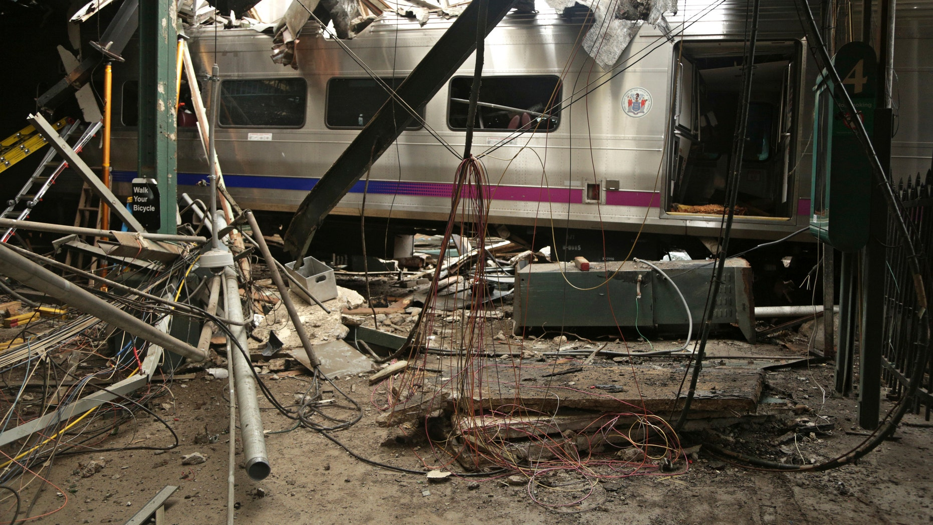 This Oct. 1, 2016, file photo provided by the National Transportation Safety Board shows damage from a Sept. 29, 2016, commuter train crash that killed a woman and injured more than 100 people at the Hoboken Terminal in Hoboken, N.J. Thomas Gallagher, the engineer of the commuter train that slammed into the station going double the 10 mph speed limit, suffered from sleep apnea that had gone undiagnosed, his lawyer told The Associated Press on Wednesday, Nov. 16, 2016. A U.S. official told the AP that investigators are looking at it as a potential cause.