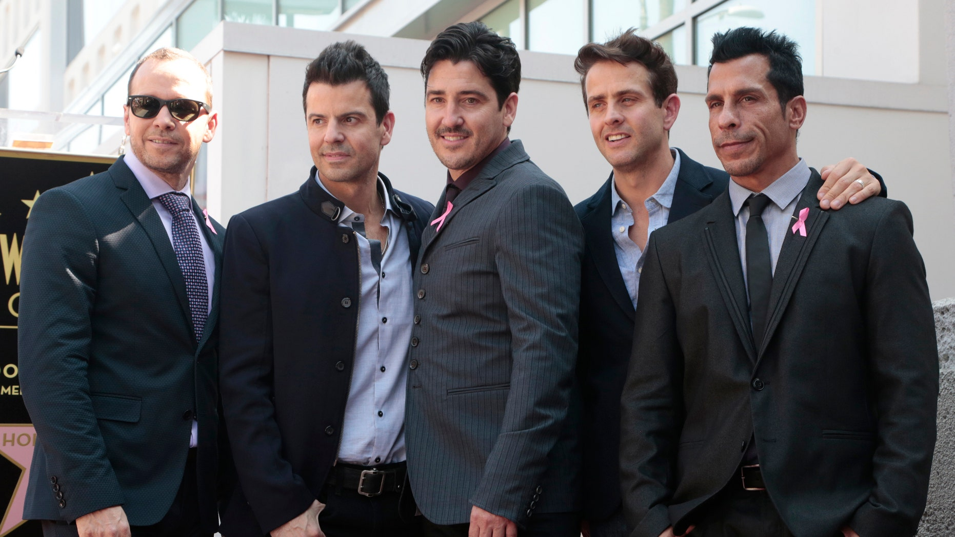 October 9, 2014. New Kids On The Block band members (L-R) Donnie Wahlberg, Jordan Knight, Jonathan Knight, Joey McIntyre and Danny Wood pose on their star after it was unveiled on the Walk of Fame in Hollywood.