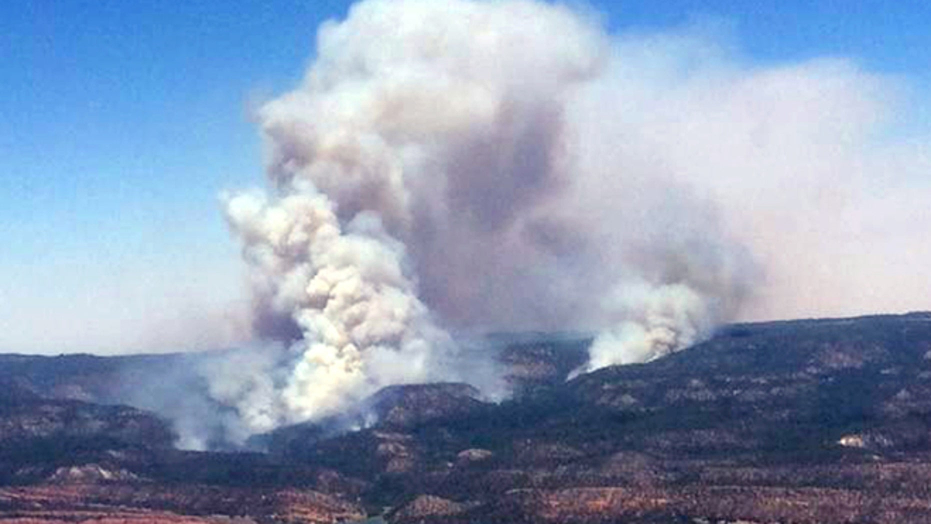 June 15, 2014: This image provided by Inci Web shows a plume of smoke in the Chuska Mountains near Naschitti, N.M.
