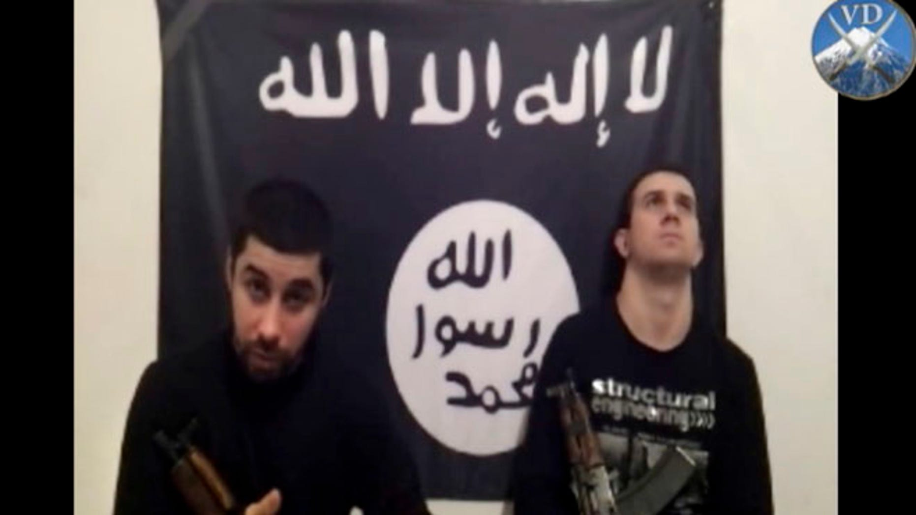 In this image made from a video posted online Sunday, Jan. 19, 2014 by an Islamic militant group asserting responsibility for suicide bombings last month that killed 34 people in Volgograd, Russia, two men, identified as Suleiman and Abdurakhman and who purportedly carried out the twin suicide bombings are seen at an unknown location.