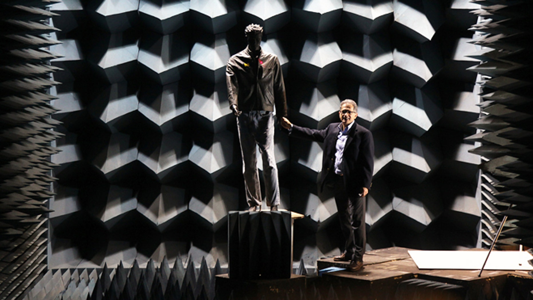 Professor Kamal Sarabandi approaches a mannequin he uses to test the radar in the anechoic chamber.In the aftermath of the Newtown school shooting, a University of Michigan, College of Engineering professor Kamal Sarabandienvisions a new use for a weapons-detecting radar system heâs been developing for thepast few years. The technology could potentially identify a hidden gun or bomb on anapproaching person from the distance of a football field away in less than a second.