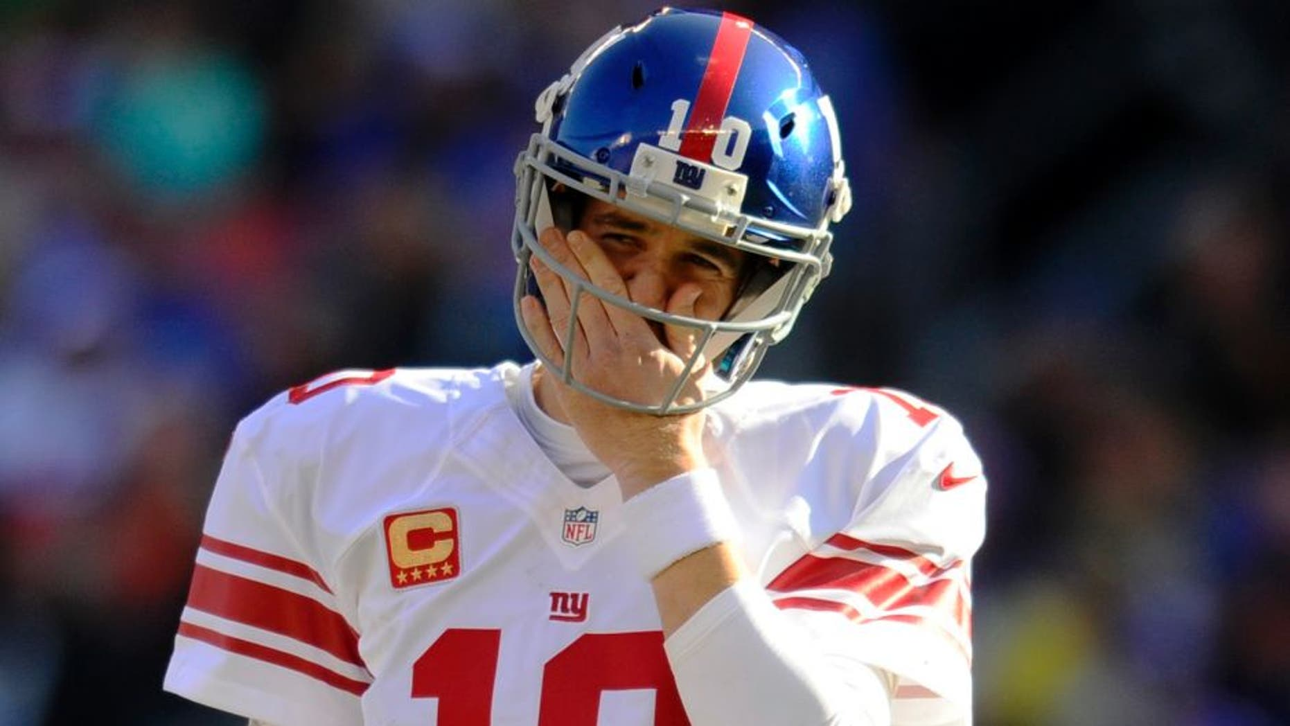 CLEVELAND, OH - NOVEMBER 27, 2016: Quarterback Eli Manning #10 of the New York Giants wipes his face as he walks onto the field during a game against the Cleveland Browns on November 27, 2016 at FirstEnergy Stadium in Cleveland, Ohio. New York won 27-13. (Photo by: Nick Cammett/Diamond Images/Getty Imges)