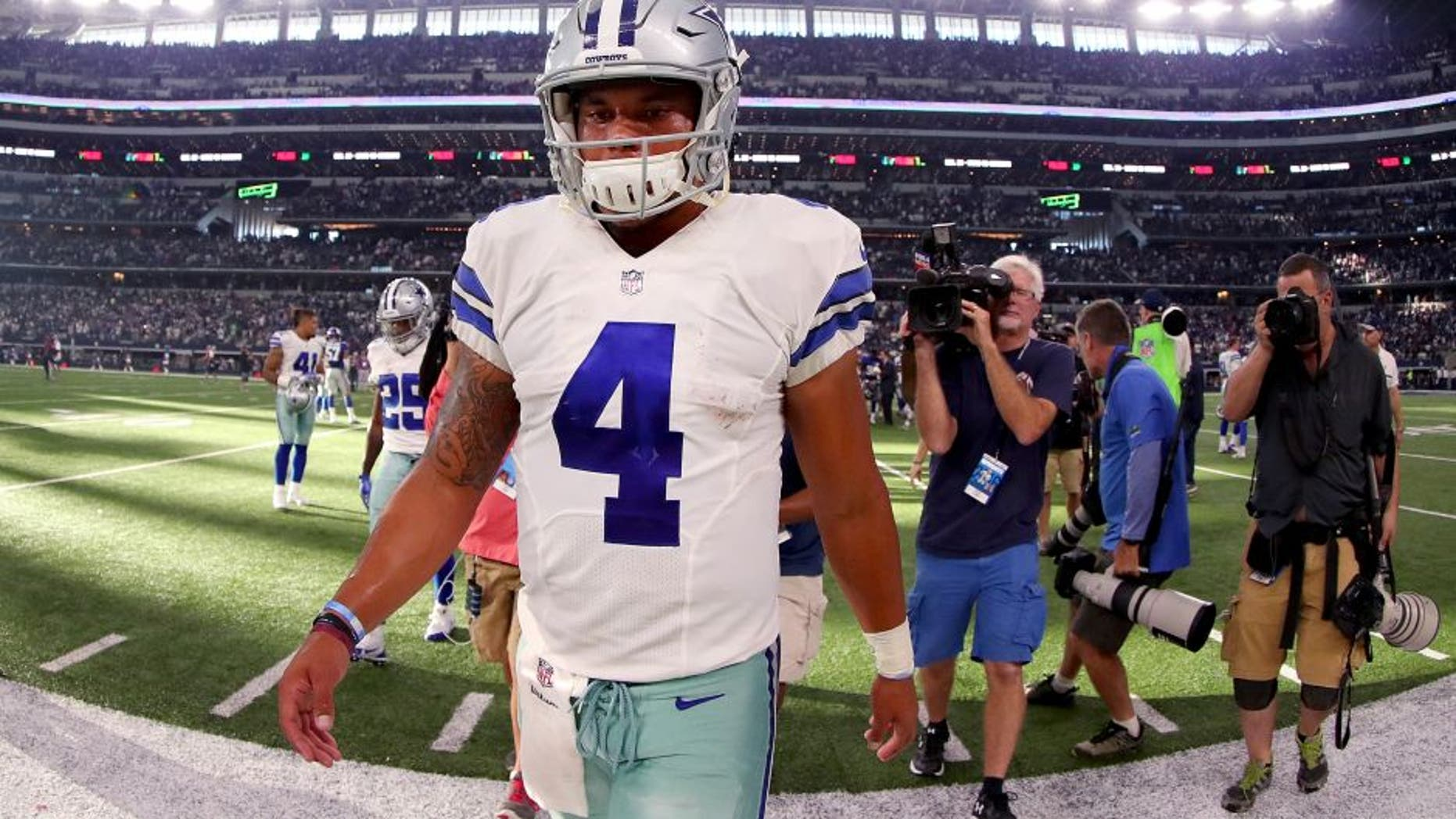 ARLINGTON, TX - SEPTEMBER 11: Dak Prescott #4 of the Dallas Cowboys walks off the field after losing to the New York Giants 20-19 at AT&T Stadium on September 11, 2016 in Arlington, Texas. (Photo by Tom Pennington/Getty Images)