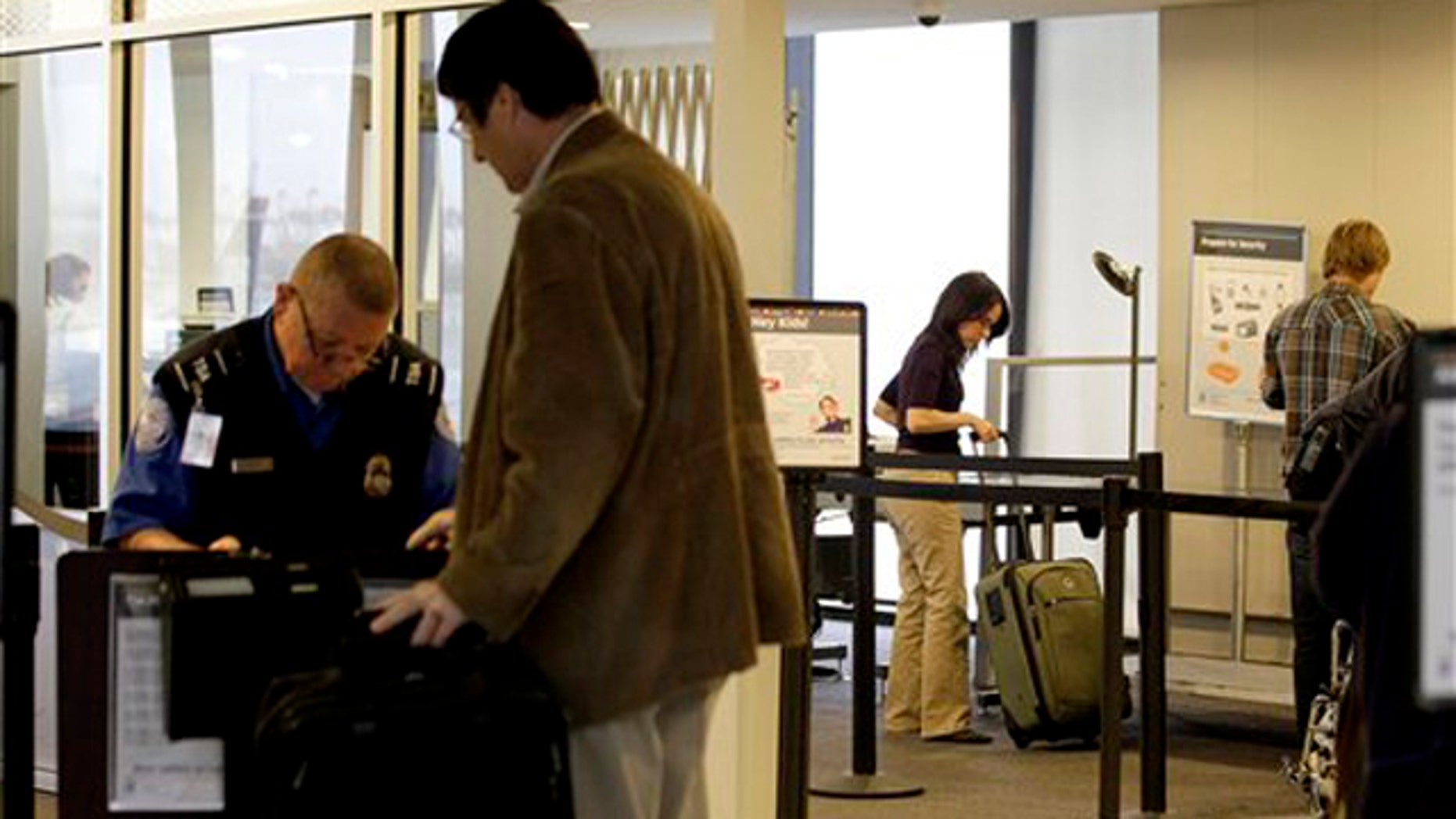 Nov. 17, 2011: Travelers are seen at the security area of Newark Liberty International Airport in Newark, N.J.