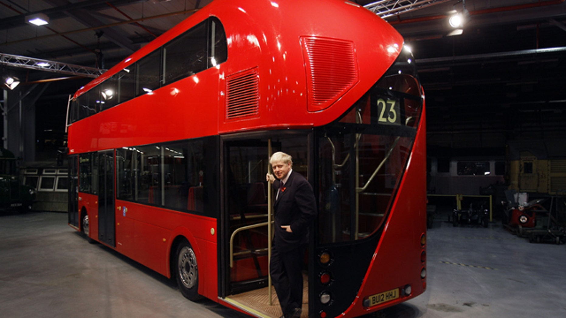 The Mayor of London Boris Johnson poses for a photograph at a press call to unveil the full size static mock-up of the New Bus for London, at Acton Transport Depot in London, Thursday, Nov. 11, 2010.