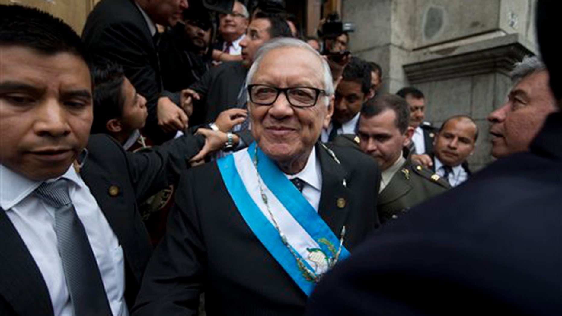 Sept. 3, 2015: Guatemala's new President Alejandro Maldonado leaves the Congress building after his swearing-in ceremony in Guatemala City.