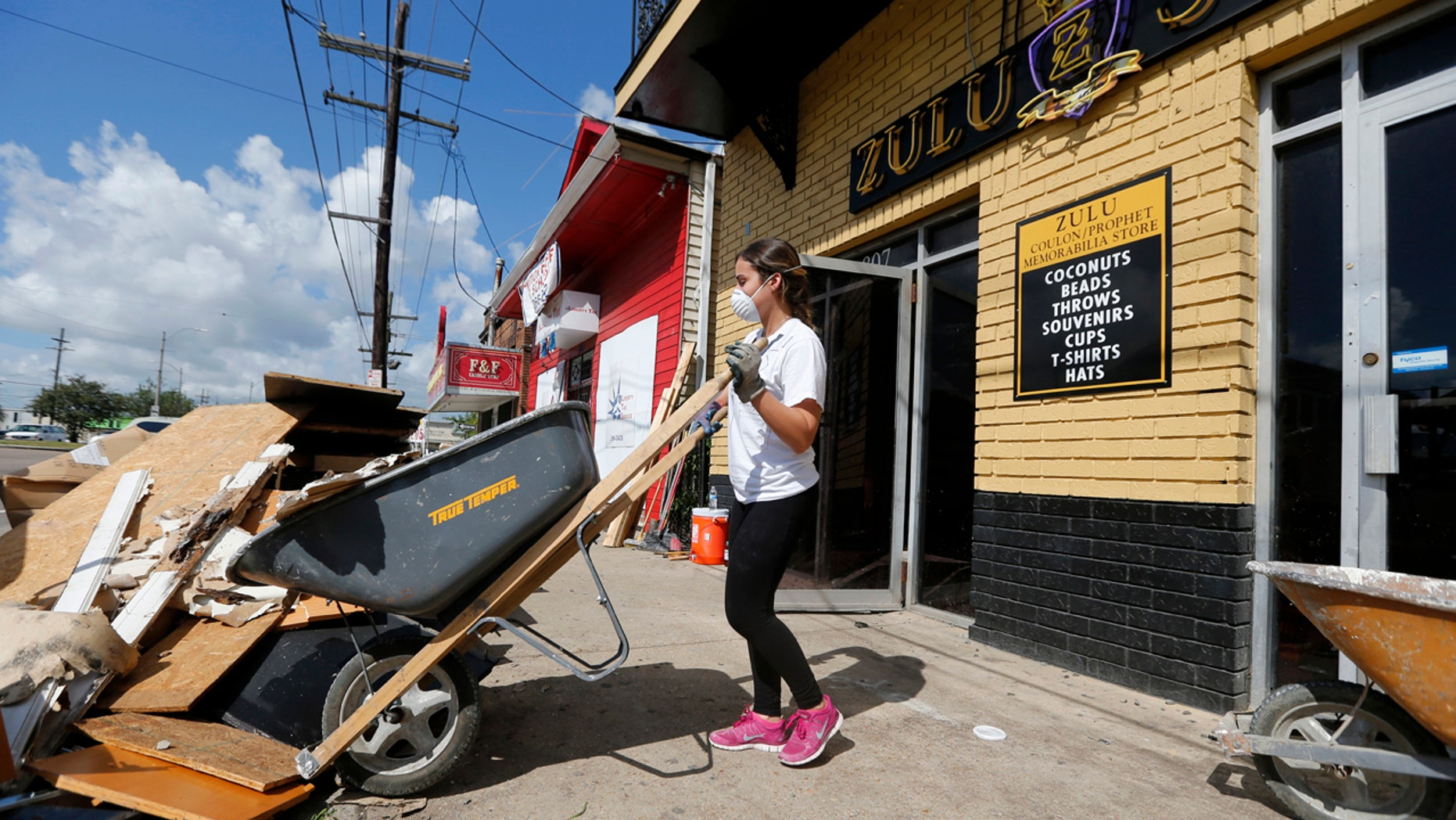 Pre-med student Sheila Tendero, from the Miami Medical Team, helps gut the Zulu Social Aid & Pleasure Club Store in New Orleans, which flooded during storms.