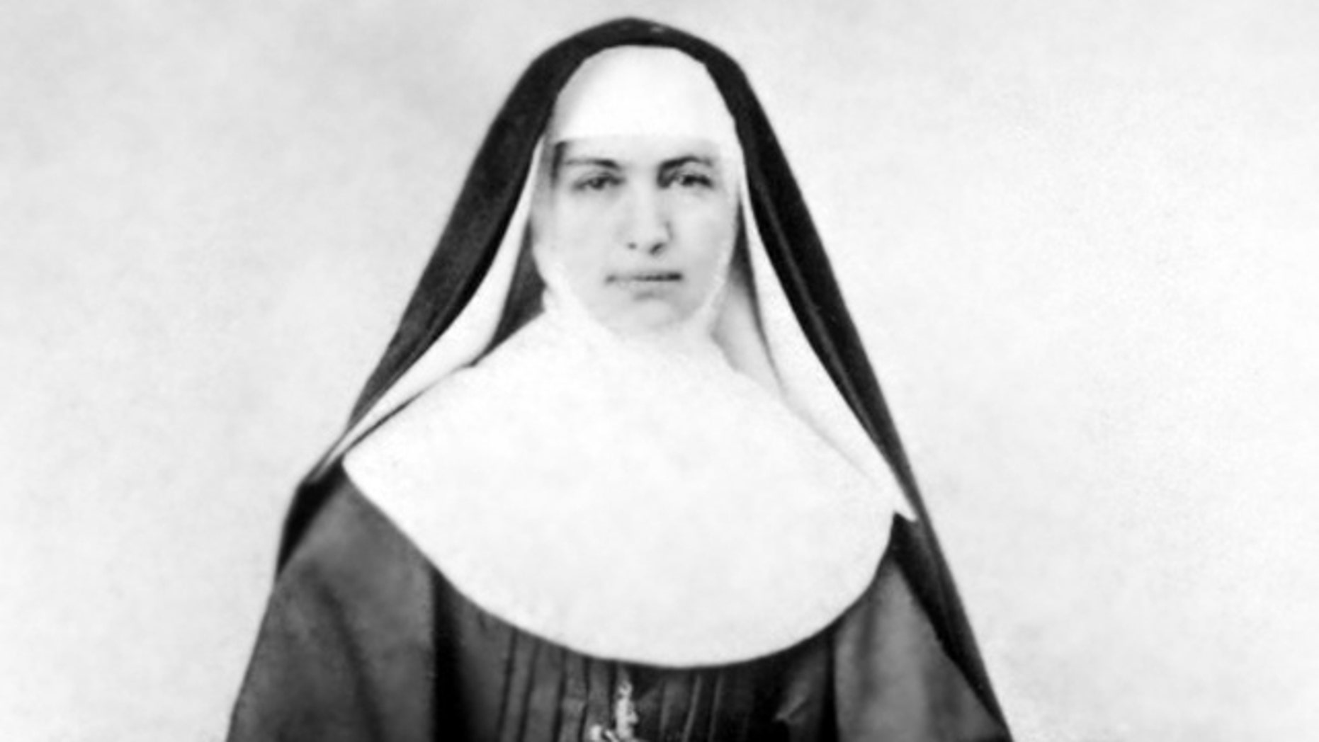 """This 1883 file photo provided by the Sisters of St. Francis of the Neumann Communities shows Mother Marianne Cope, a nun who dedicated her life to caring for exiled leprosy patients on Kalaupapa in Hawaii. Mother Marianne gave her life to caring for Hawaii's leprosy patients, outcasts that others stayed away from at the time out of fear they might contract the disfiguring disease. On Oct. 21, 2012, almost a century after she died at the remote Kalaupapa leprosy settlement in 1918, the Vatican will formally recognize her as a saint. Bishop Larry Silva of the Honolulu diocese says she's """"an inspiration to us to do the hard work, to not always do the glory work, but to roll up our sleeves and do what needs to be done for the sake of our brothers and sisters."""" (AP/Sisters of St. Francis of the Neumann Communities)"""