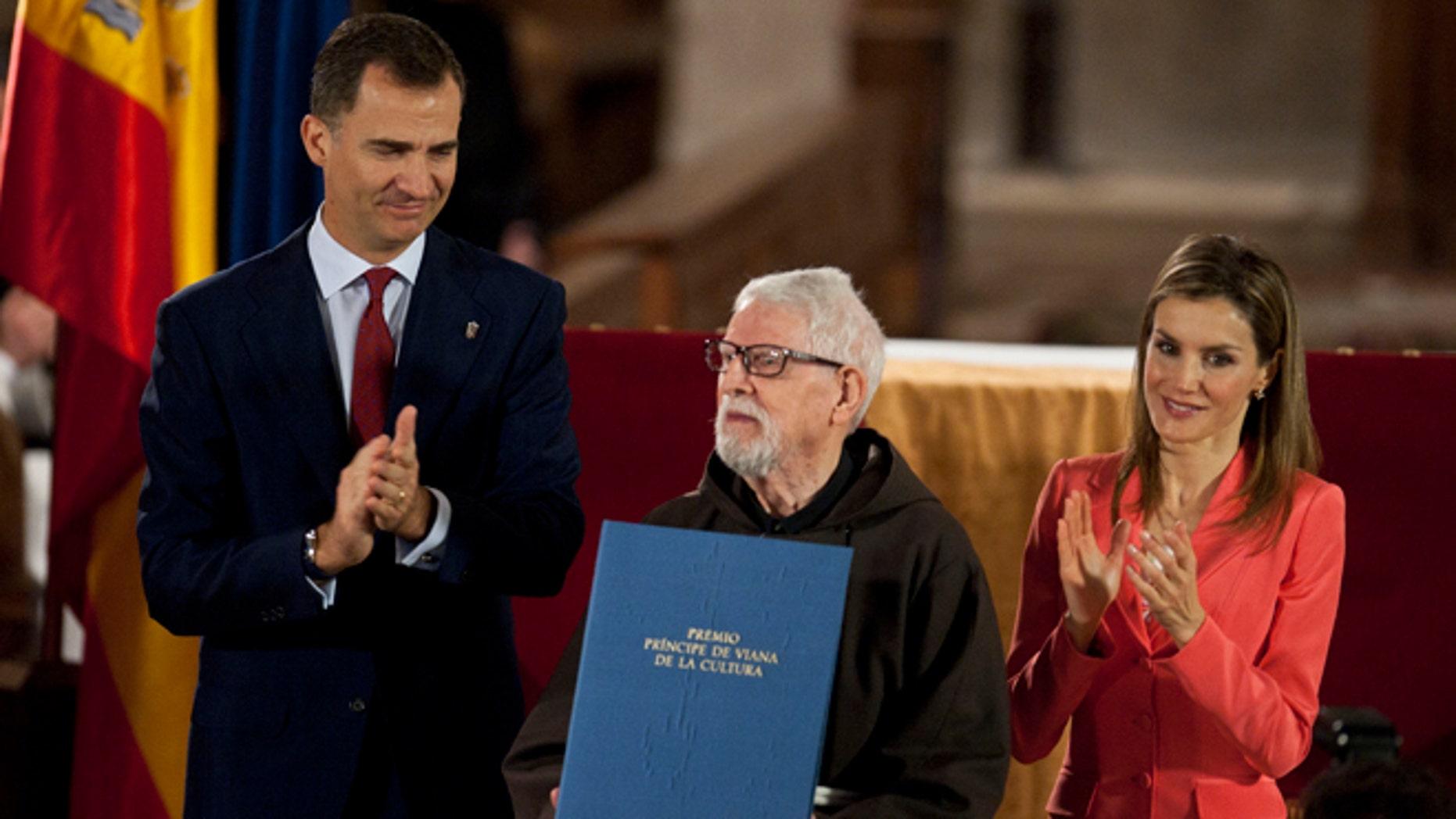 June 4, 2014: Historian Capuchino,Tarsicio de Azcona, center, receives the Prince's Viana Award, from Spain's Prince Felipe at the Monastery of Leyre, 40 miles from Pamplona, northern Spain. (AP)