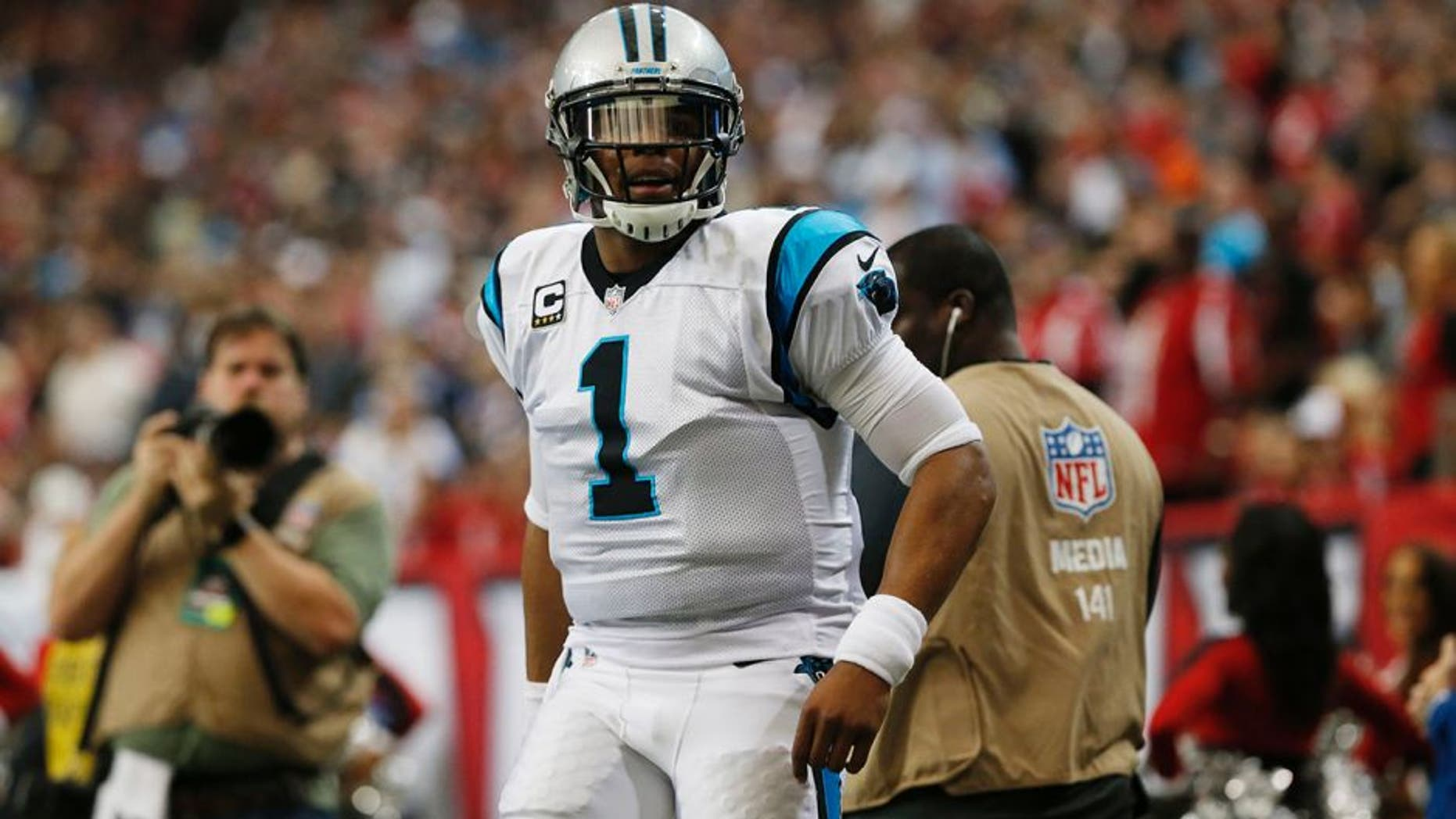 Carolina Panthers quarterback Cam Newton (1) reacts to a run against the Atlanta Falcons during the first half of an NFL football game, Sunday, Dec. 27, 2015, in Atlanta. (AP Photo/John Bazemore)