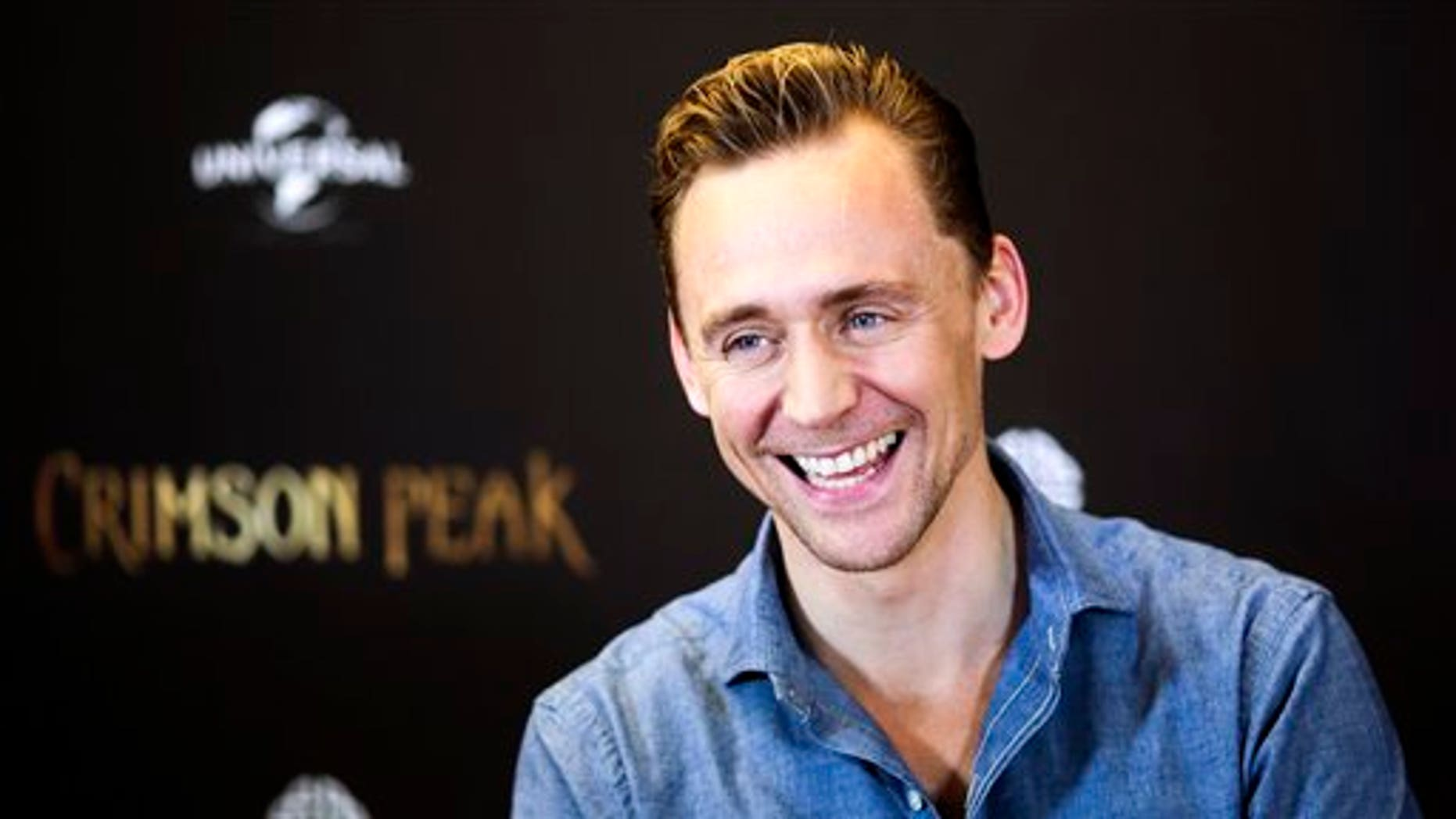 "Actor Tom Hiddleston poses during a photo-call to promote the film ""Crimson Peak"" in Berlin, Germany, on Sept. 30, 2015. (AP Photo)"