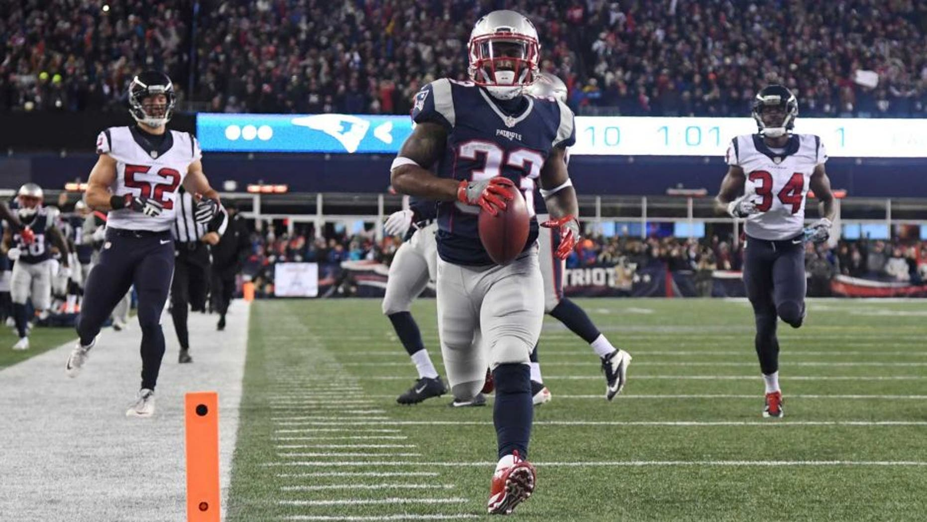 Jan 14, 2017; Foxborough, MA, USA; New England Patriots running back Dion Lewis (33)returns a kick for a touchdown against the Houston Texans during the first quarter in the AFC Divisional playoff game at Gillette Stadium. Mandatory Credit: James Lang-USA TODAY Sports