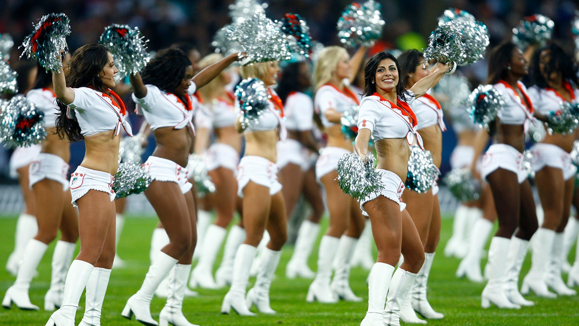 A former Miami Dolphins cheerleader filed a complaint against the team and the NFL on Thursday alleging that she was discriminated against because of her Christian beliefs.