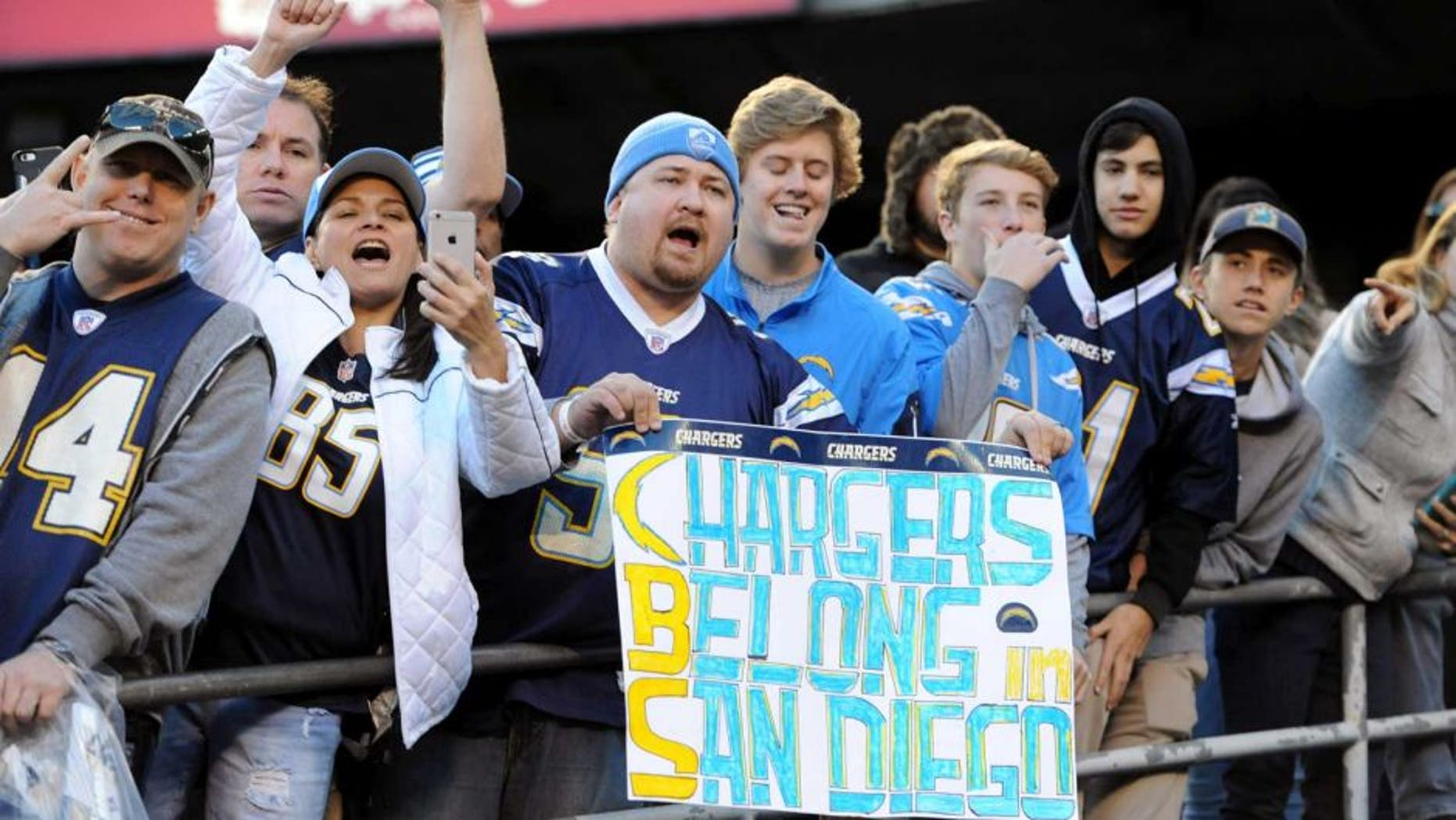 Jan 1, 2017; San Diego, CA, USA; A San Diego Chargers fan holds up a sign referencing the possible move to Los Angeles by the team during the second half of the game against the Kansas City Chiefs at Qualcomm Stadium. The Chiefs won 37-27. Mandatory Credit: Orlando Ramirez-USA TODAY Sports
