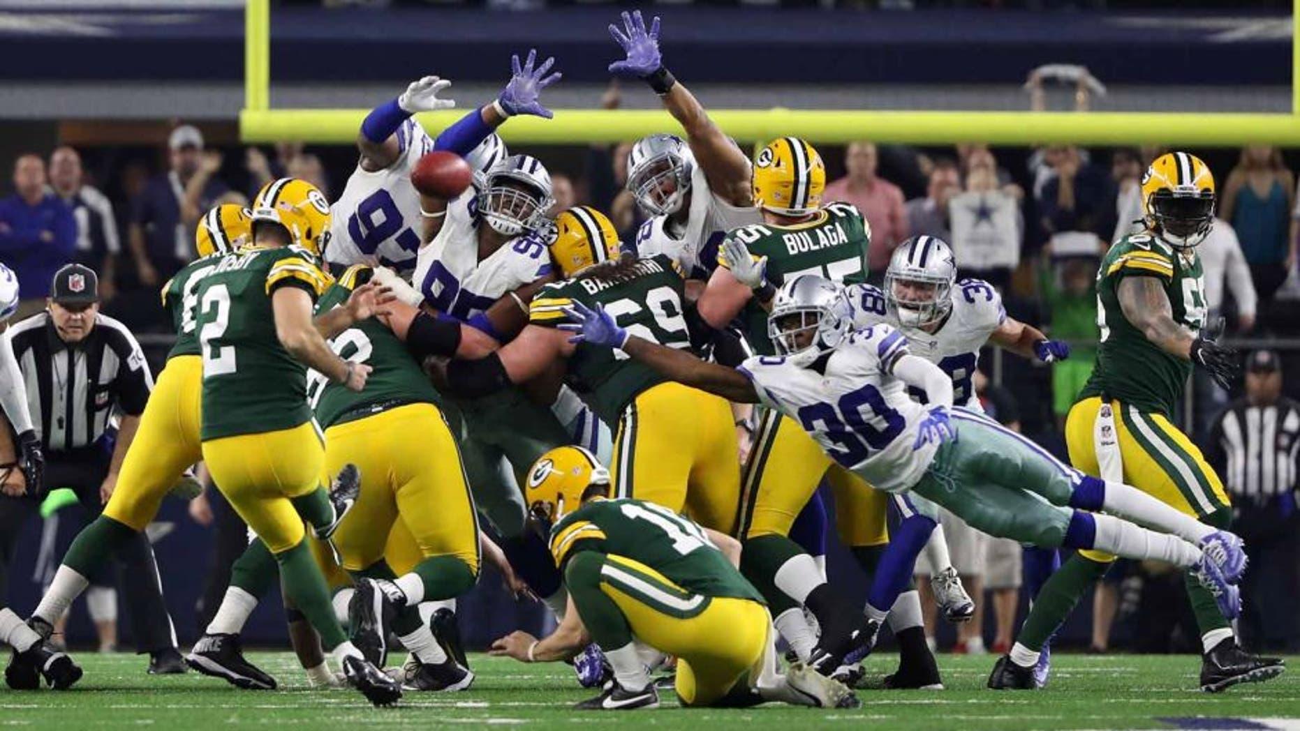 Jan 15, 2017; Arlington, TX, USA; Green Bay Packers kicker Mason Crosby (2) kicks the game winning field goal during the fourth quarter against the Dallas Cowboys in the NFC Divisional playoff game at AT&T Stadium. Mandatory Credit: Kevin Jairaj-USA TODAY Sports