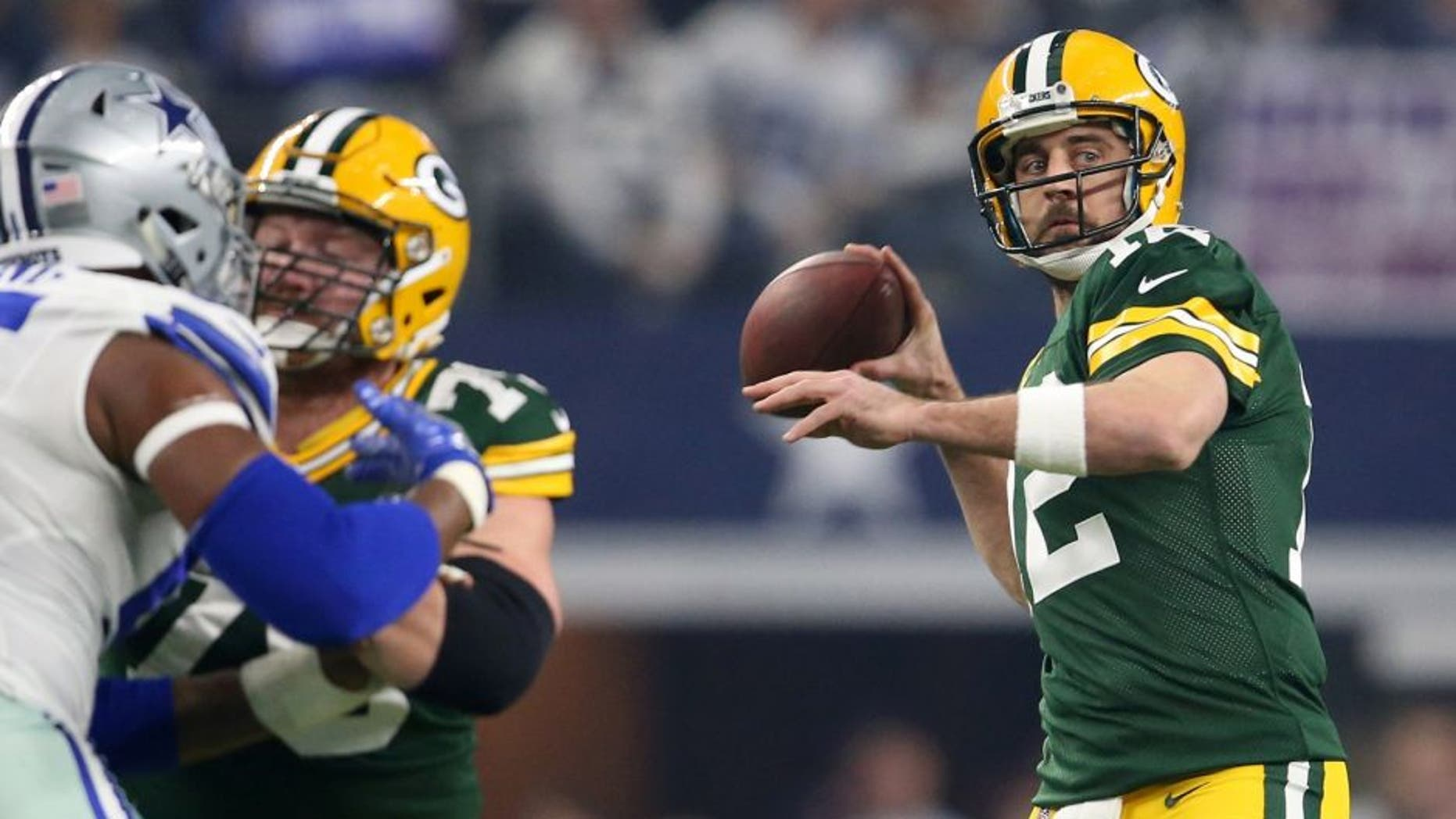 Jan 15, 2017; Arlington, TX, USA; Green Bay Packers quarterback Aaron Rodgers (12) throws a pass against the Dallas Cowboys during the first quarter in the NFC Divisional playoff game at AT&T Stadium. Mandatory Credit: Matthew Emmons-USA TODAY Sports