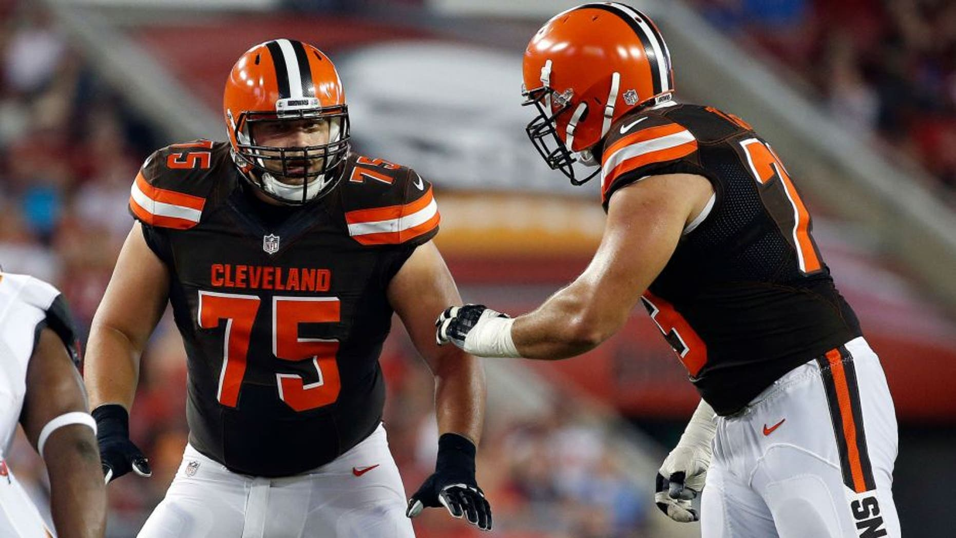 Aug 26, 2016; Tampa, FL, USA; Cleveland Browns guard Joel Bitonio (75) and tackle Joe Thomas (73) talk against the Tampa Bay Buccaneers during the first quarter at Raymond James Stadium. Mandatory Credit: Kim Klement-USA TODAY Sports