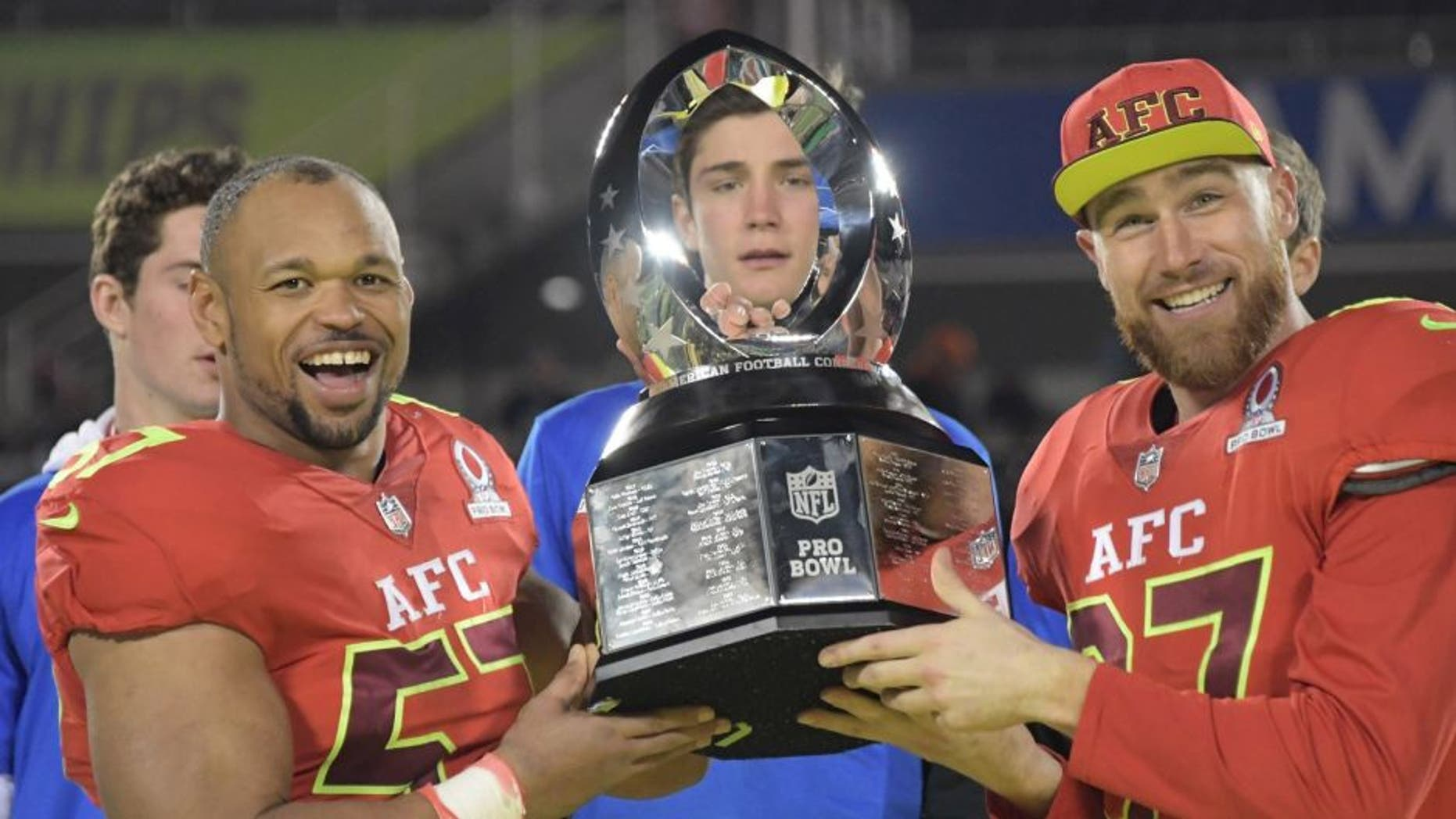 Jan 29, 2017; Orlando, FL, USA; AFC linebacker Lorenzo Alexander of the Buffalo Bills (57) and tight end Travis Kelce of the Kansas City Chiefs (87) hold the Pro Bowl trophy after the 2017 Pro Bowl at Camping World Stadium. The AFC defeated the NFC 20-13. Mandatory Credit: Kirby Lee-USA TODAY Sports