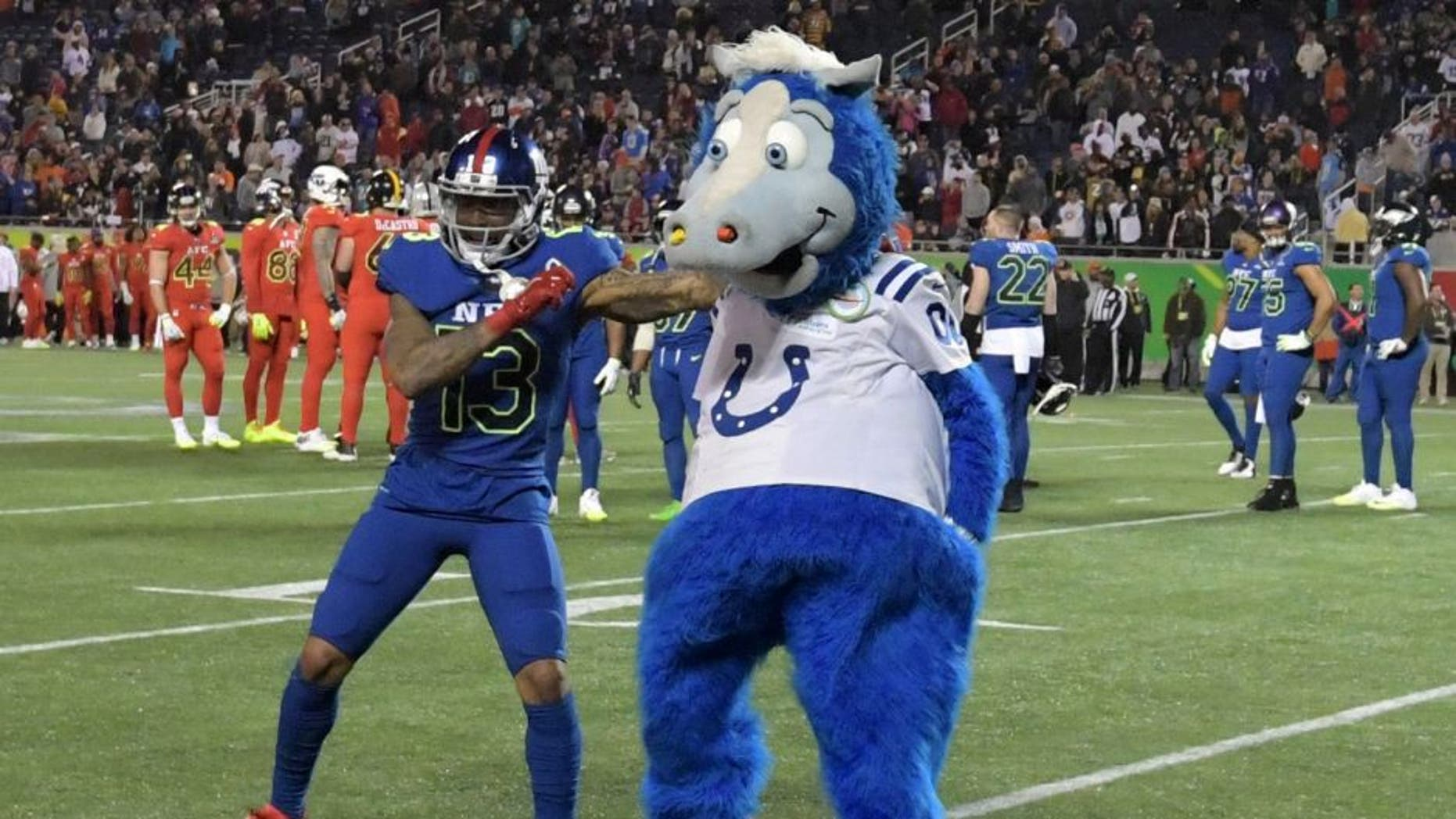 Jan 29, 2017; Orlando, FL, USA; NFC receiver Odell Beckham Jr. of the New York Giants (13) dances with Indianapolis Colts mascot Blue during the 2017 Pro Bowl at Camping World Stadium. The AFC defeated the NFC 20-13. Mandatory Credit: Kirby Lee-USA TODAY Sports
