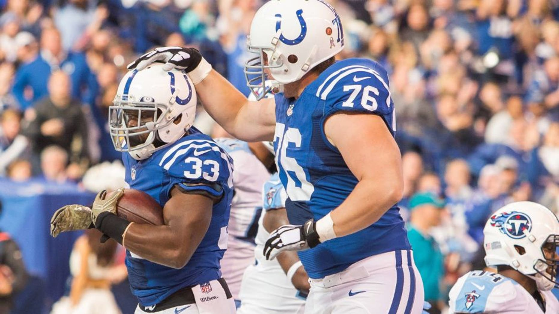 Nov 20, 2016; Indianapolis, IN, USA; Indianapolis Colts running back Robert Turbin (33) celebrates his touchdown with offensive tackle Joe Reitz (76) in the first quarter the game against the Tennessee Titans at Lucas Oil Stadium. Mandatory Credit: Trevor Ruszkowski-USA TODAY Sports