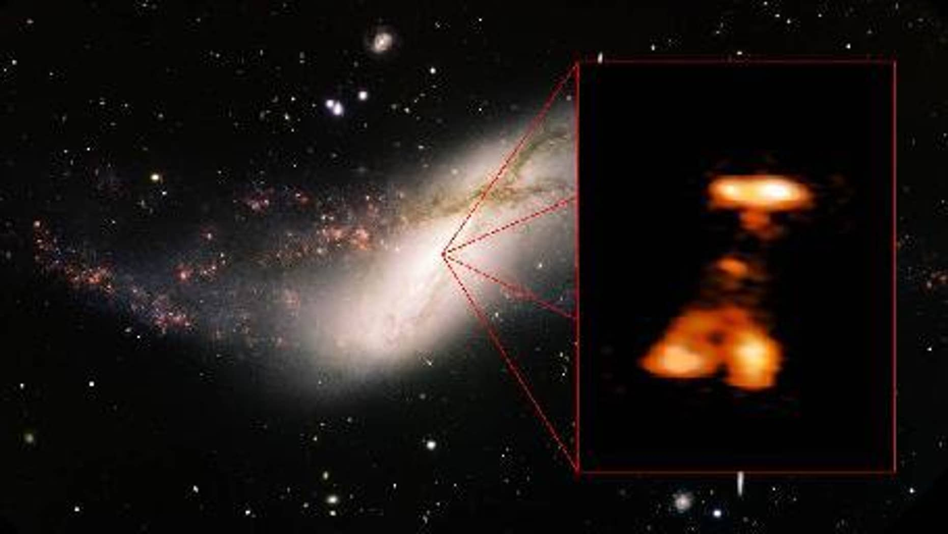 A massive outburst erupts from the giant black hole at the center of the distant galaxy NGC 660, which is 44 million light-years from Earth, in this via captured by ground-based telescopes. Image released Jan. 7, 2013.