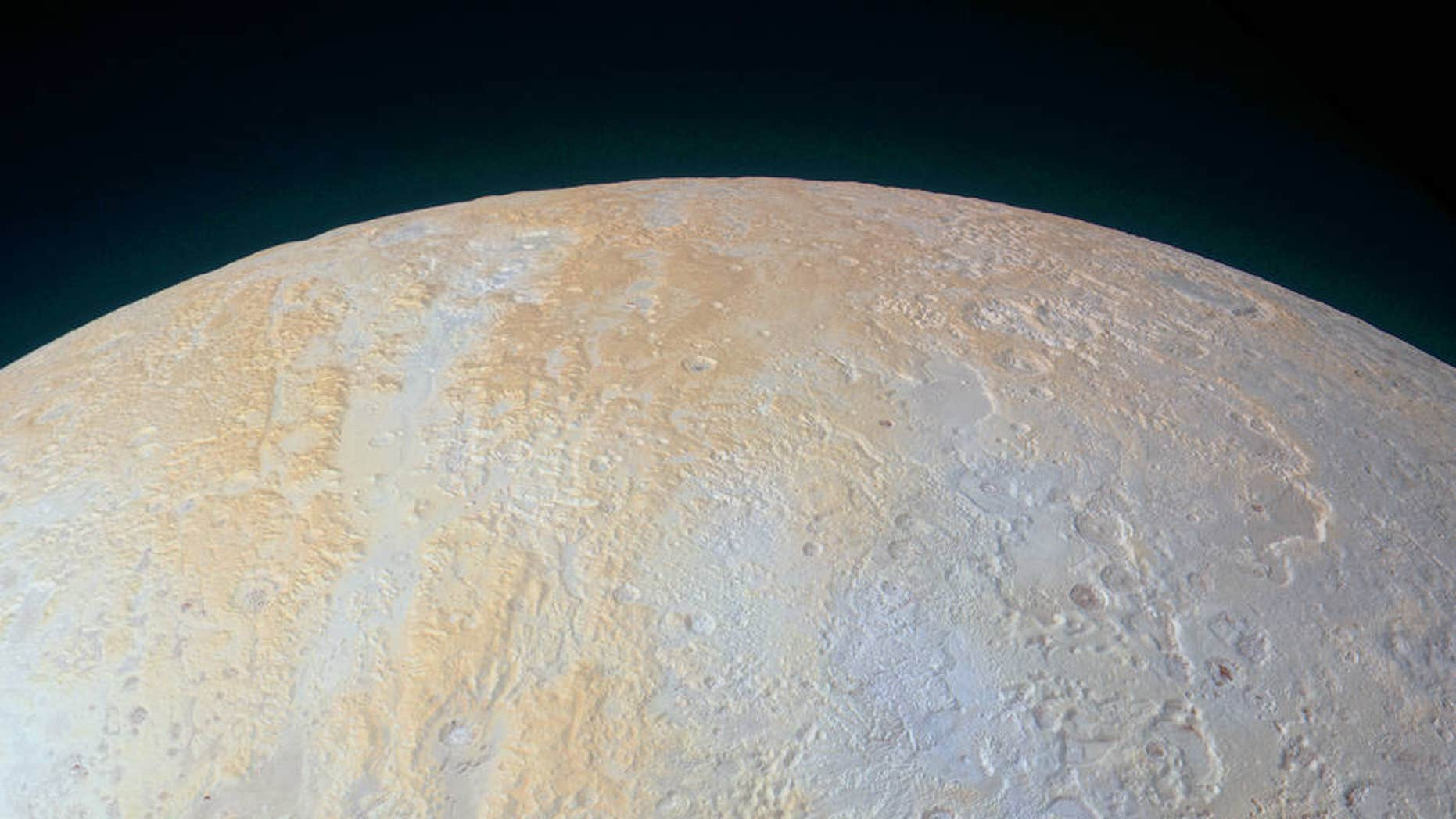 This ethereal scene captured by NASA's New Horizons spacecraft tells yet another story of Pluto's diversity of geological and compositional features—this time in an enhanced color image of the north polar area. (NASA)