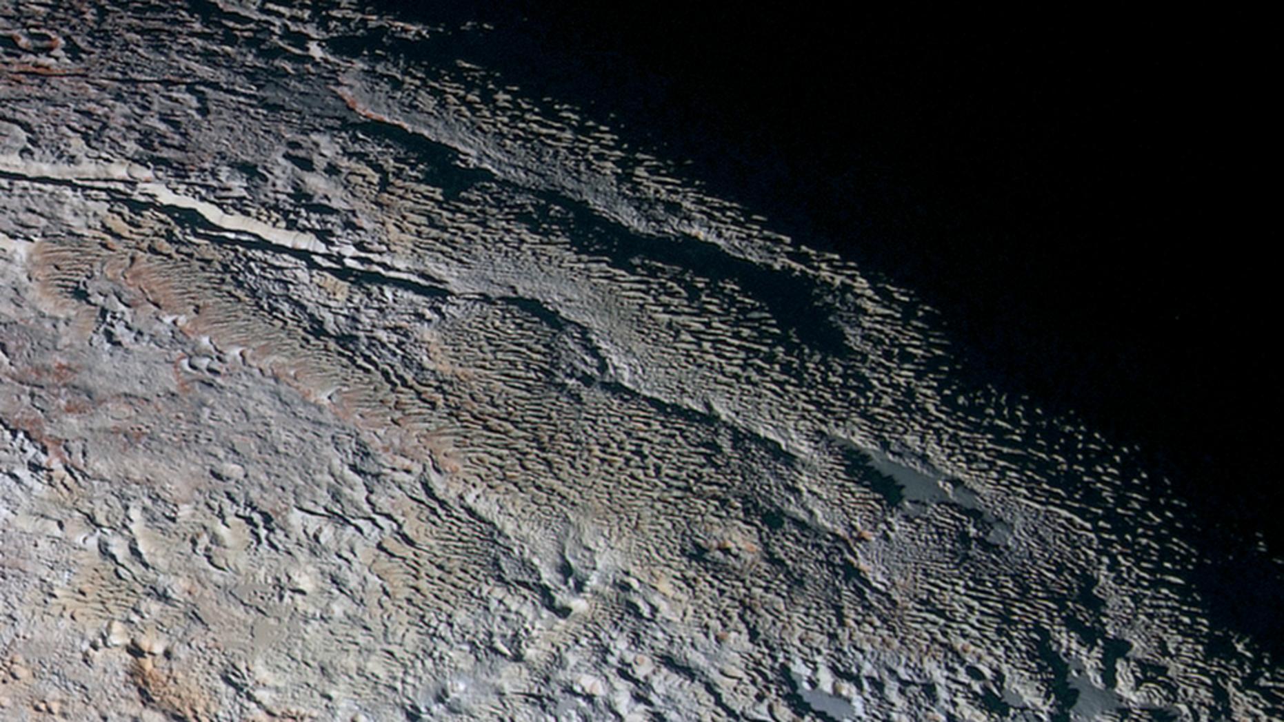 The bladed terrain of Pluto's informally named Tartarus Dorsa region, imaged by NASA's New Horizons spacecraft in July 2015. (Credits: NASA/JHUAPL/SwRI)
