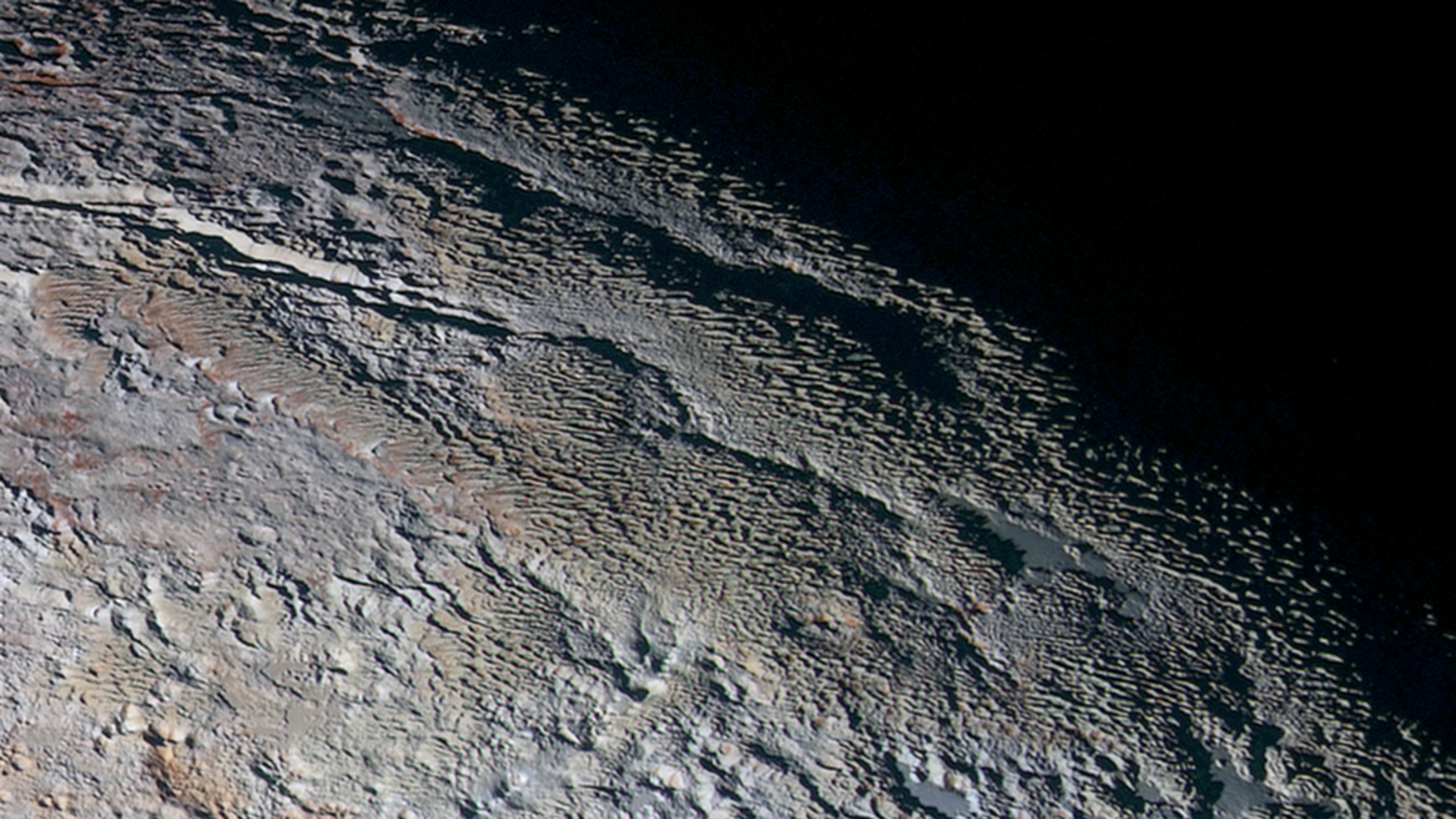 The bladed terrain of Pluto's informally named Tartarus Dorsa region, imaged by NASA's New Horizons spacecraft in July 2015. (Credits: NASA/JHUAPL/SwRI)