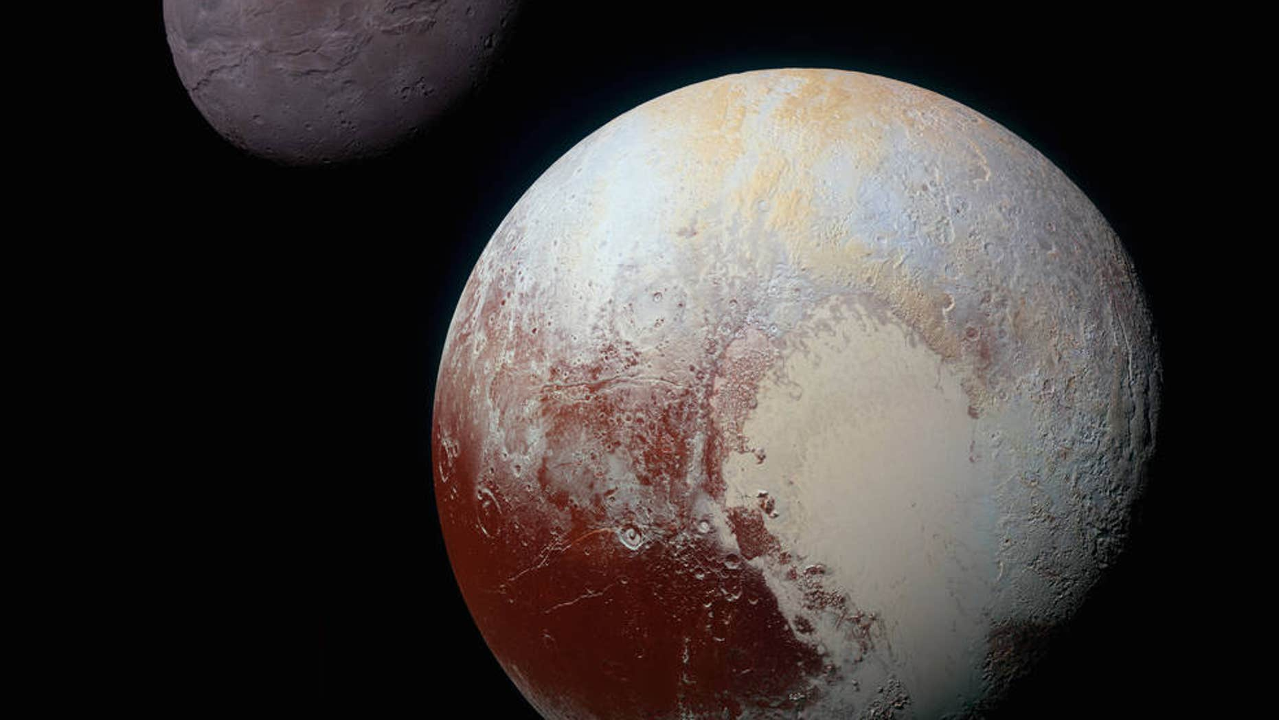 This composite, enhanced-color image of Pluto (lower right) and its largest moon, Charon (upper left), was taken by NASA's New Horizons spacecraft on July 14, 2015. Pluto and Charon are shown with approximately correct relative sizes, but their true separation is not to scale.