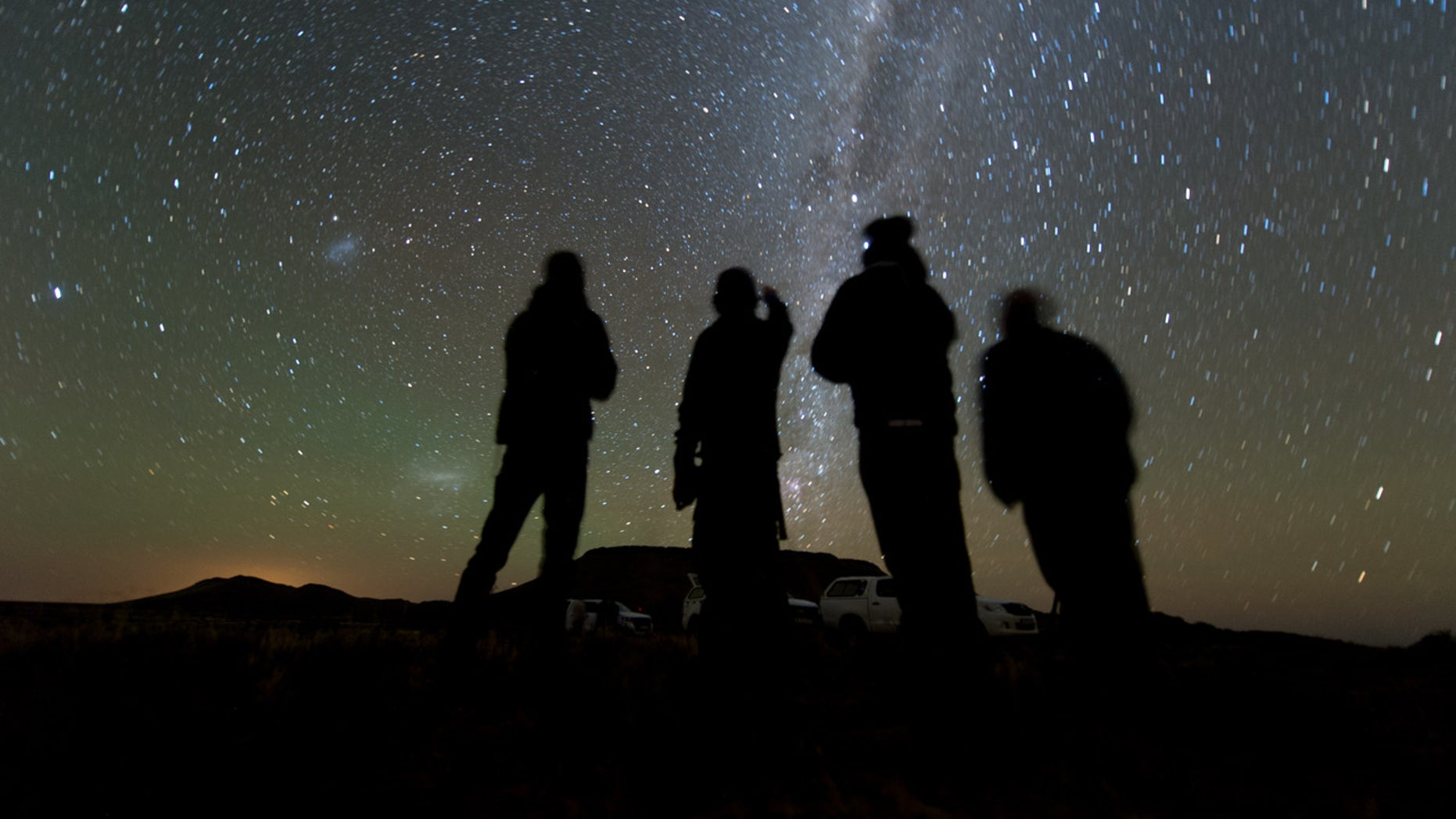Four members of the New Horizons' South African observation team scan the sky while waiting for the start of the 2014 MU69 occultation, early on the morning of June 3, 2017.