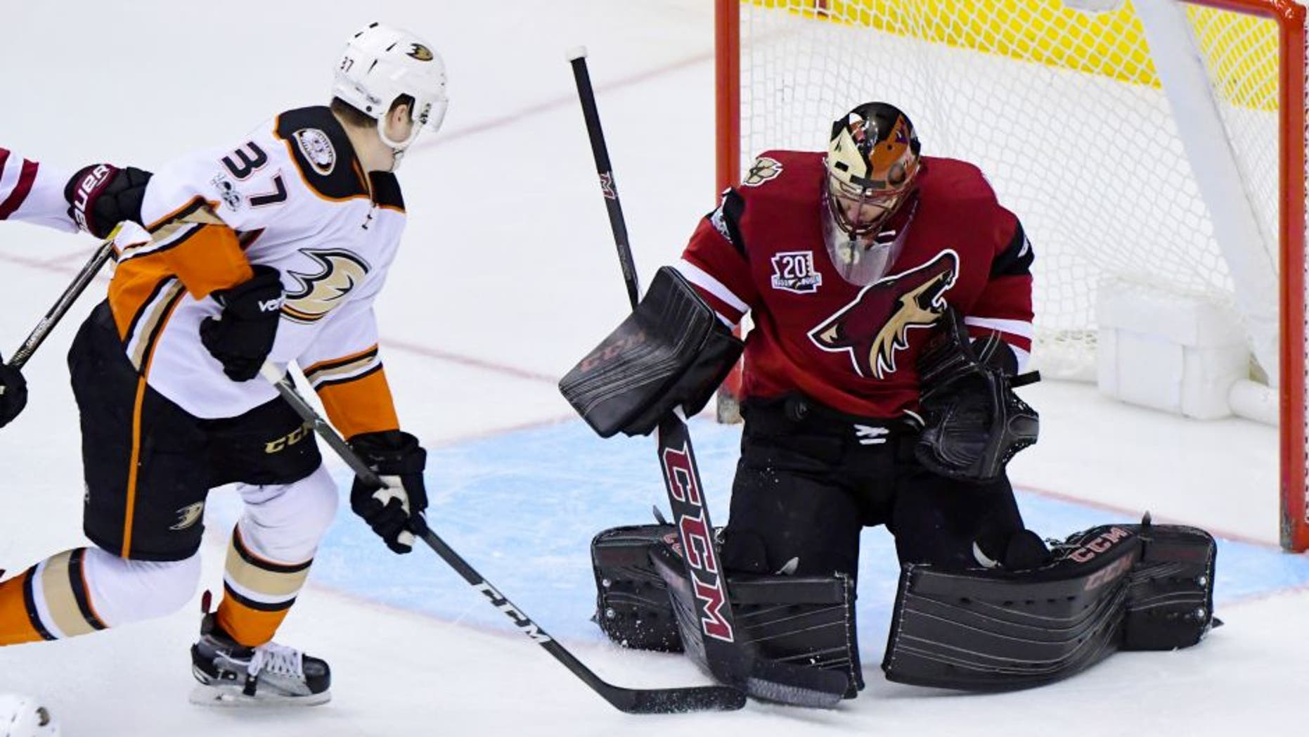 Feb 20, 2017; Glendale, AZ, USA; Arizona Coyotes goalie Mike Smith (41) makes a save against Anaheim Ducks left wing Nick Ritchie (37) during the second period at Gila River Arena. Mandatory Credit: Matt Kartozian-USA TODAY Sports