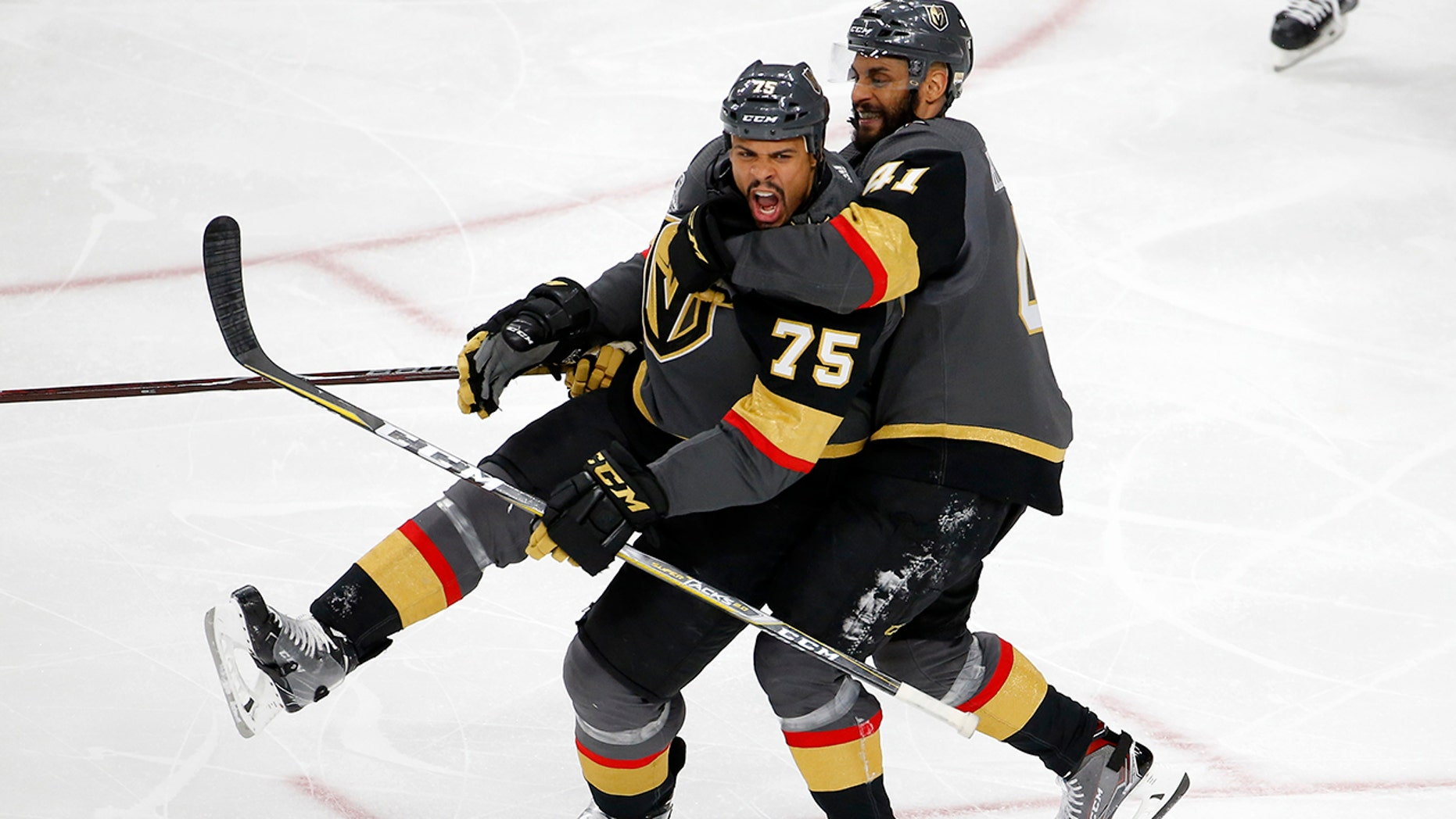 Vegas Golden Knights right wing Ryan Reaves, left, celebrates his goal with left wing Pierre-Edouard Bellemare, of France, during the third period in Game 1 of the NHL hockey Stanley Cup Finals against the Washington Capitals Monday, May 28, 2018, in Las Vegas.