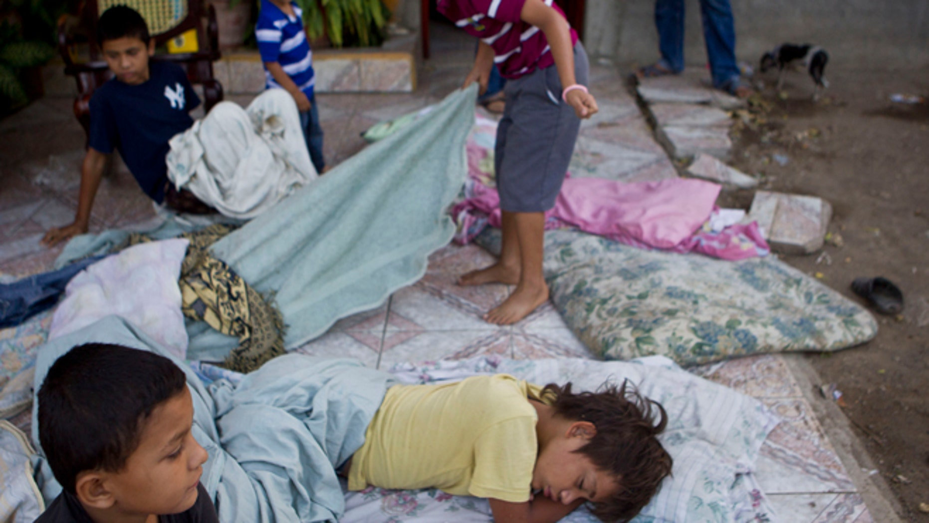 Apr. 11, 2014: Children lie on a mattress outside their home after a strong earthquake in Nagarote, Nicaragua.
