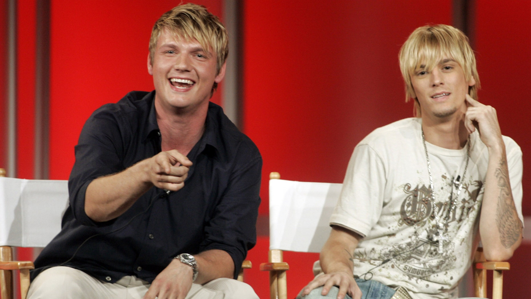Singers and brothers Nick (L) and Aaron Carter answer questions about their new reality television program 'House of Carters' which features them and their three sisters on E! Networks during a session at a Cable Television Critics Association press tour in Pasadena, California July 11, 2006. The series will premiere in October 2006. REUTERS/Fred Prouser (UNITED STATES) - RTR1FEQR