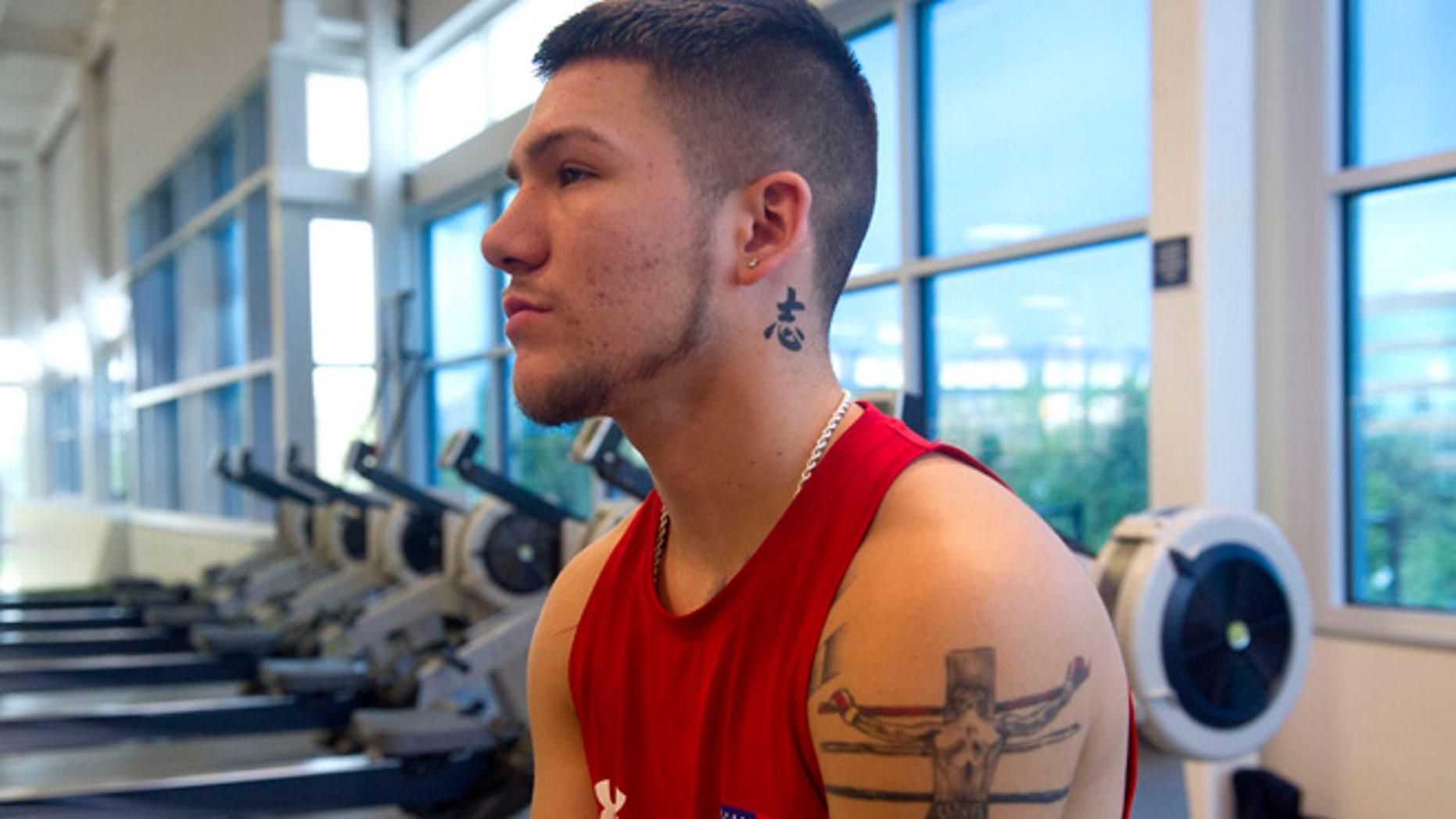 Team USA boxer, Nico Hernandez, rests after finishing his workout at the Ted Stevens Sports Services Center, part of the US Olympic Training Center in Colorado Springs, Colorado, May 25, 2016.US athletes were training in preparation for the upcoming Olympics in Rio de Janeiro, Brazil.   / AFP / Jason Connolly        (Photo credit should read JASON CONNOLLY/AFP/Getty Images)