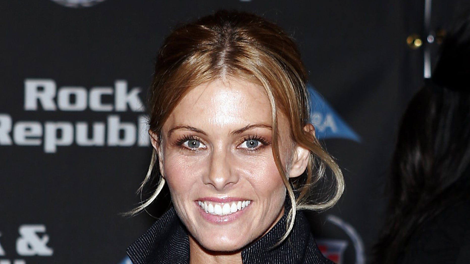 Actress Nicole Eggert arrives at the Cadillac Rock&Republic Fall 2005 Fashion Show at Sony Studios in Culver City, California March 19, 2005. REUTERS/Gene Blevins  GB/CCK - RTR5JCI