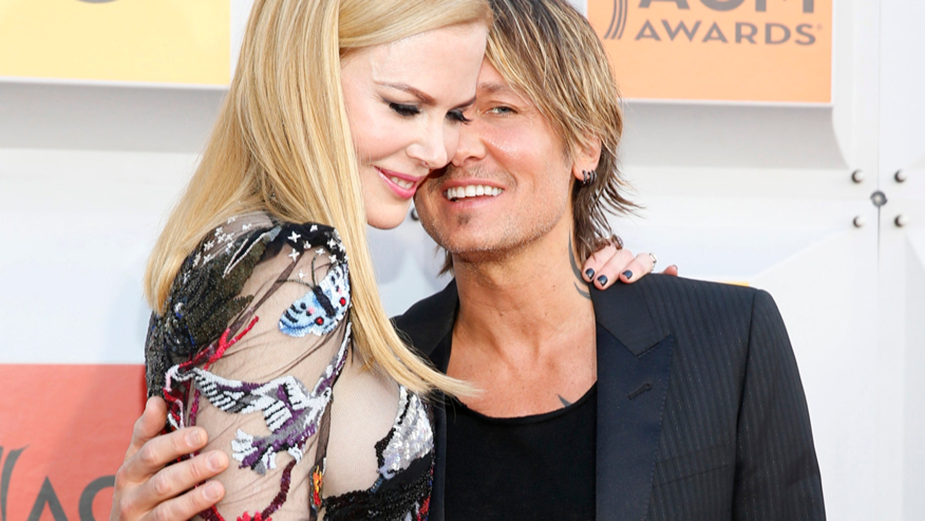 Actress Nicole Kidman And Musician Keith Urban Arrive At The St Academy Of Country Music Awards