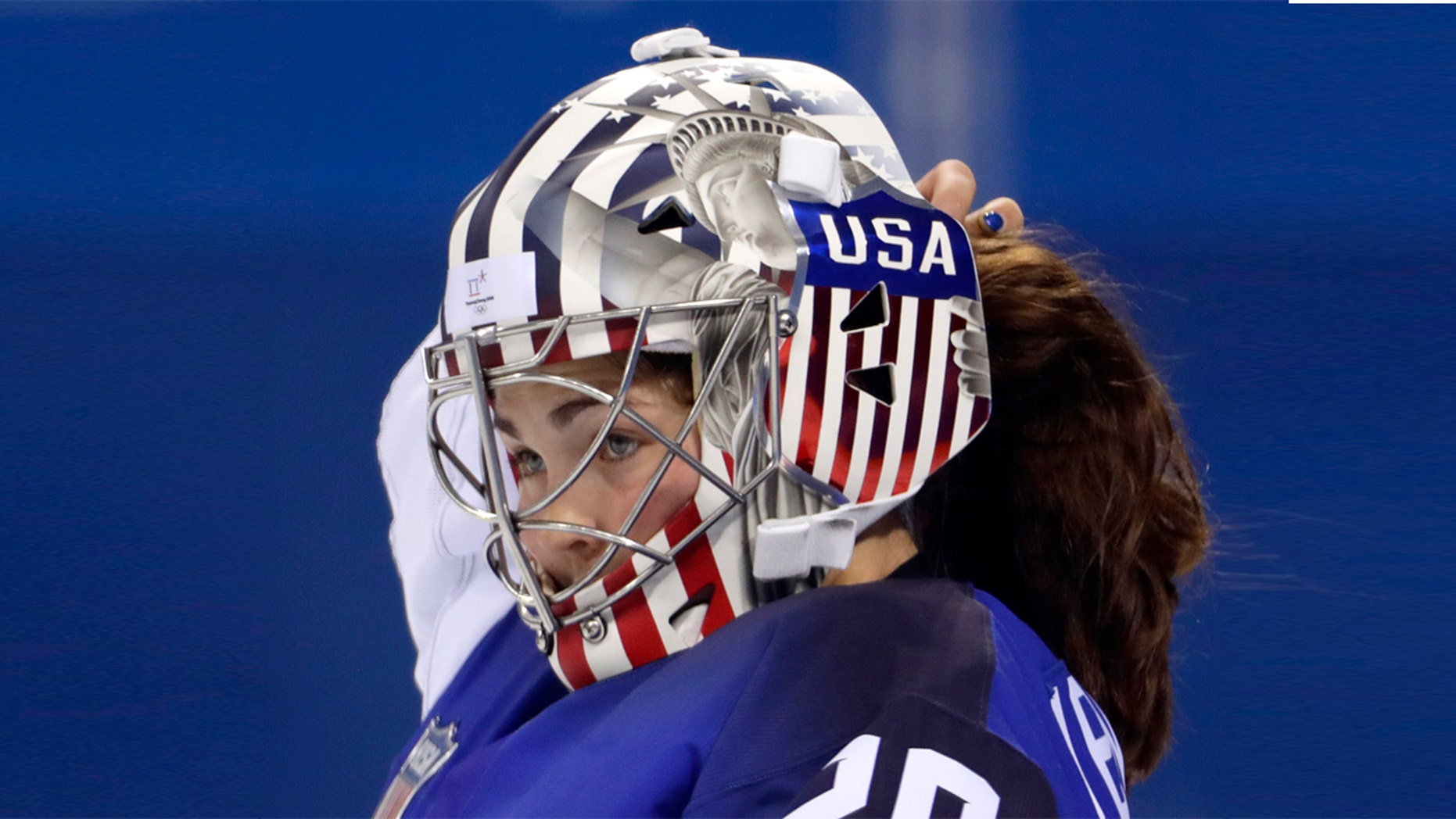 Team USA hockey goalkeeper Nicole Hensley, pictured, has been cleared by the International Olympic Committee to display the Statue of Liberty on her helmet as she competes in the 2018 Winter Games.