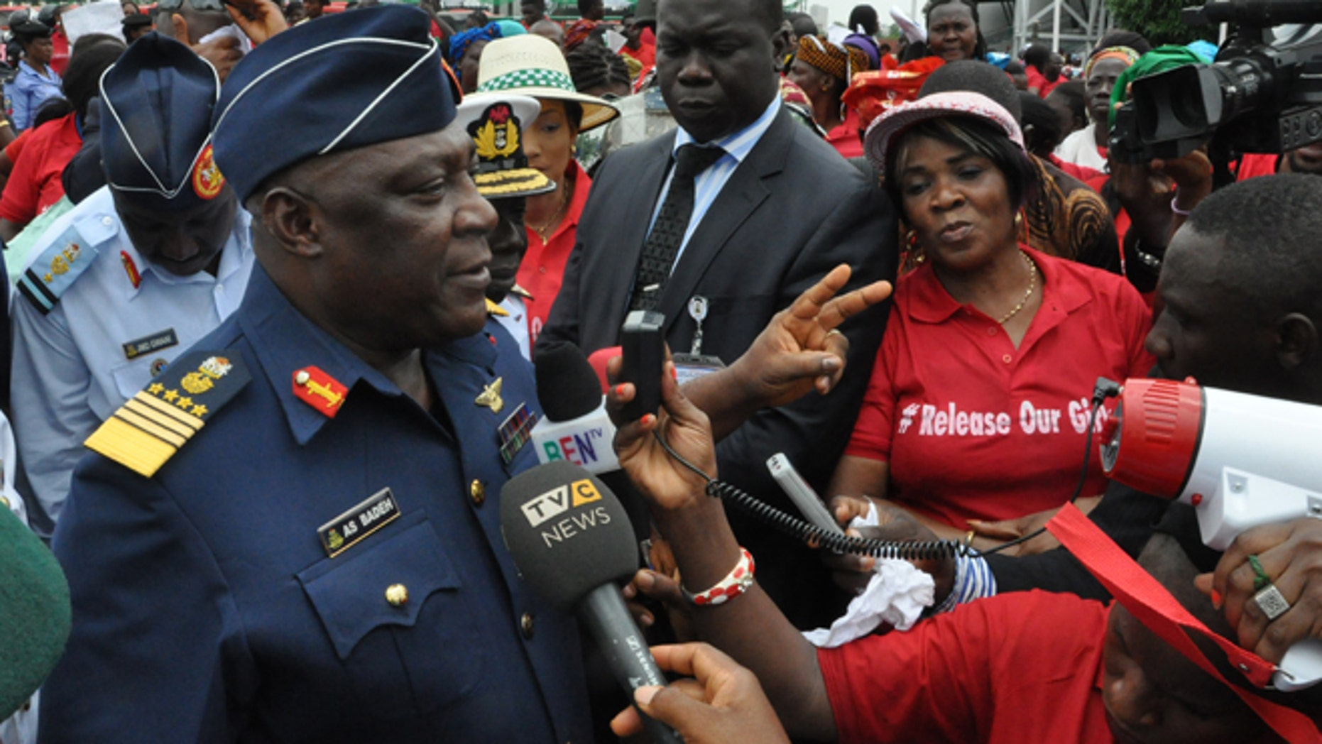 May 26, 2014: Nigeria's chief of defense staff Air Marshal Alex S. Badeh, center, speaks during a demonstration calling on the government to rescue the kidnapped girls of the government secondary school in Chibok, in Abuja, Nigeria, Monday.