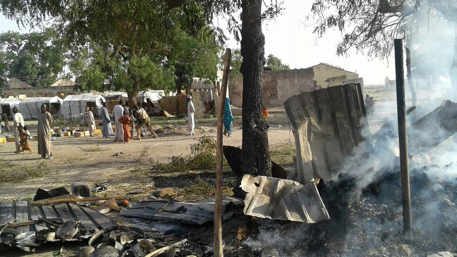 In this image supplied by MSF, smoke rises from a burnt out shelter at a camp for displaced people in Rann, Nigeria, Tuesday Jan. 17, 2017.