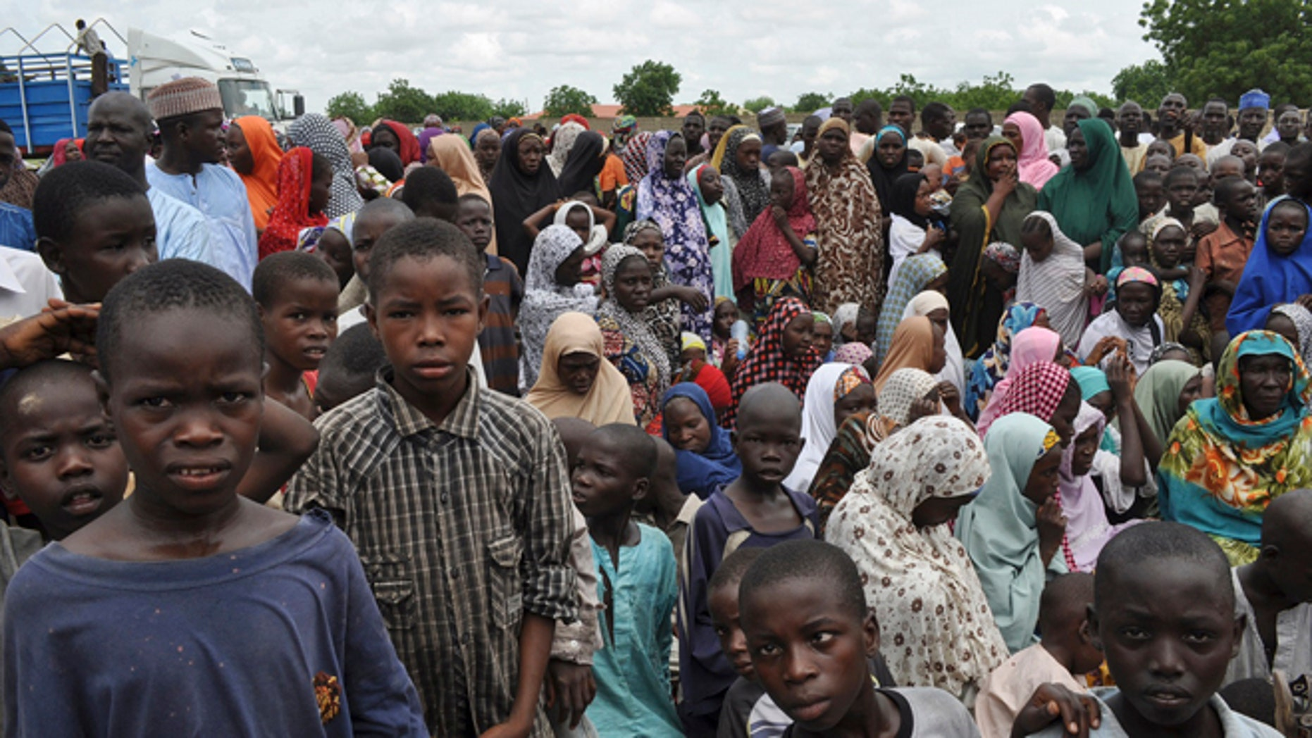 Sept. 9, 2014: Civilians who fled their homes following an attack by Islamist militants in Bama take refuge at a school in Maiduguri, Nigeria.