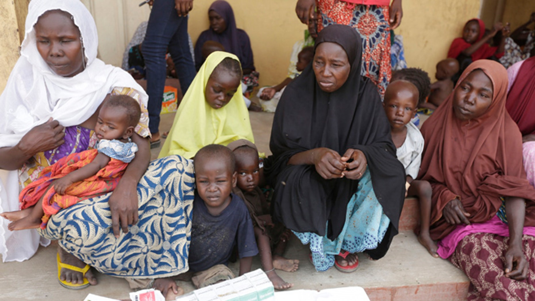 Women and children rescued by Nigerian soldiers from Boko Haram extremists at Sambisa Forest wait for treatment at a refugee camp in Yola, Nigeria. Boko Haram fighters stoned captives to death, some girls and women were crushed by an armored car and three died when a land mine exploded as they walked to freedom.  (AP Photo/Sunday Alamba)