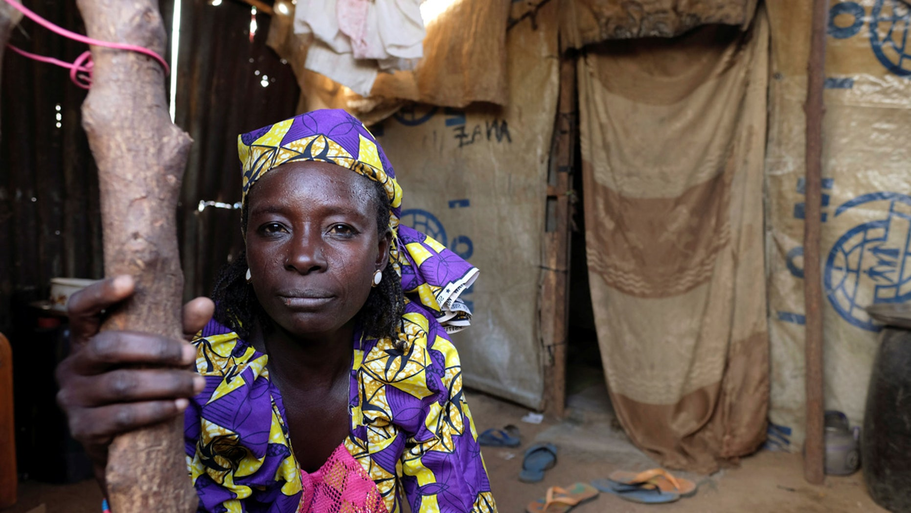 Zainab Bukar, an internally displaced person living in Bama camp, Nigeria, poses for a photograph in a shelter, Nov. 23, 2017.