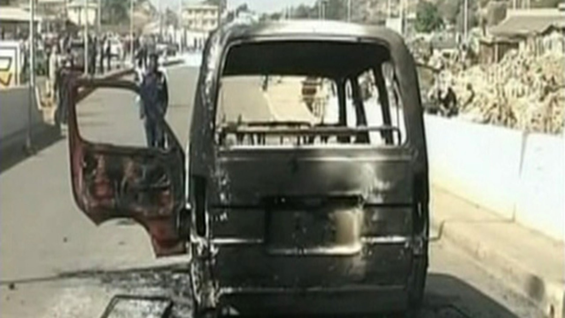Dec. 25: In this image made from video provided NTA via APTN, a burned out van is seen on a road following violence in Jos, Nigeria. Dozens of people were killed over the holiday weekend in attacks across Nigeria, including 32 that died in central Nigeria in a series of bomb blasts in the worst violence to hit the region in months. (AP)